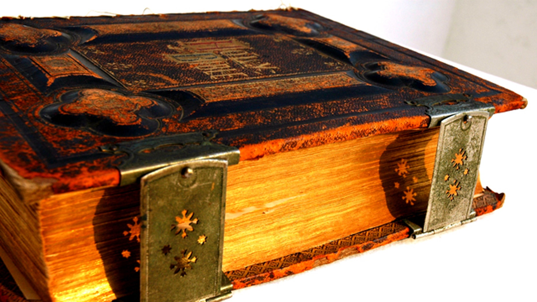 An antique copy of the Bible, printed in 1885, with metal clasps, and leather binding, is photographed in Puerto Vallarta, Jalisco, Mexico. Scientists are struggling to reconcile the tales in the Bible with modern science.