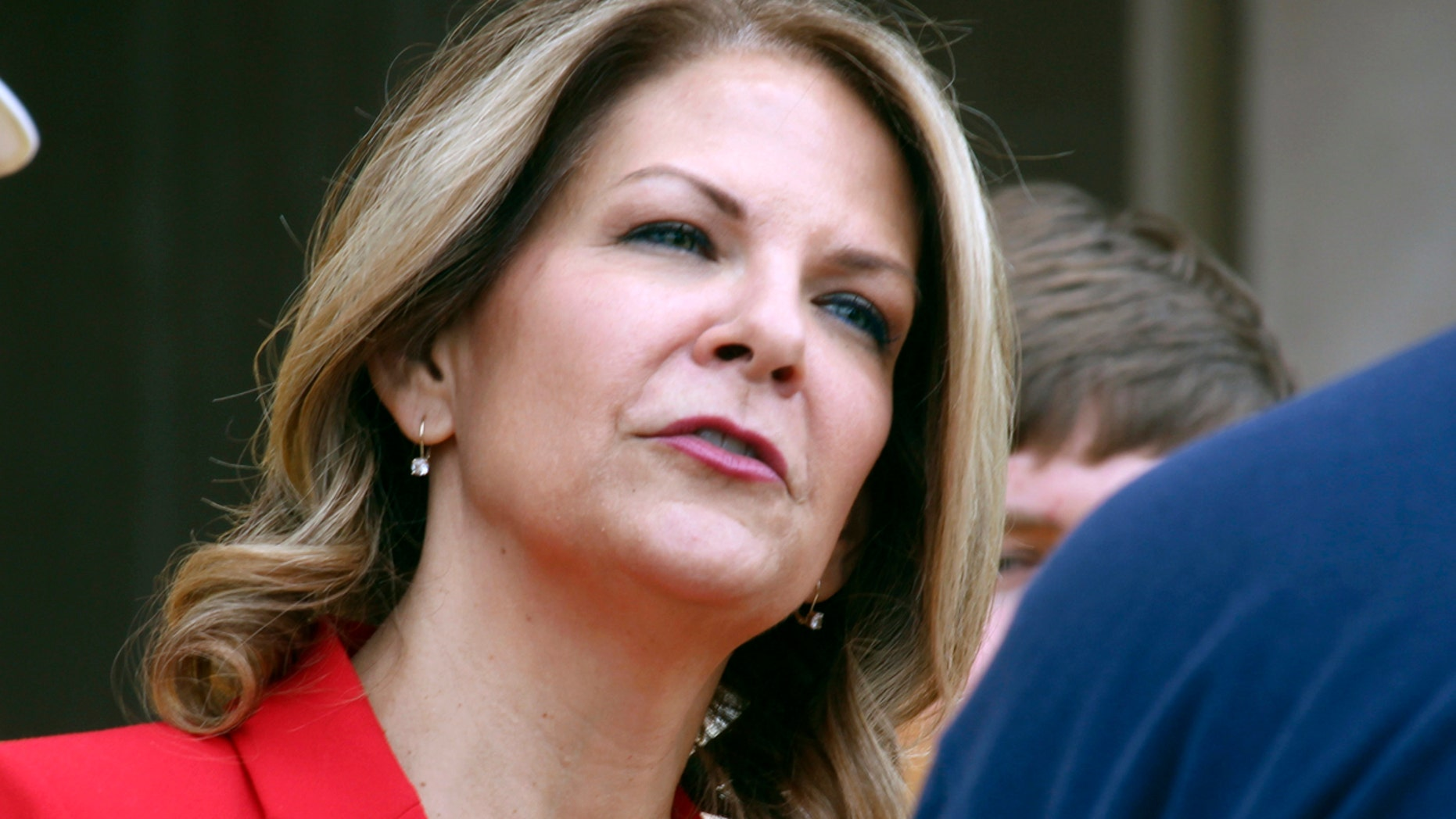 FILE: Kelli Ward speaks to the media as she prepares to file her nominating petitions at the state Capitol in Phoenix