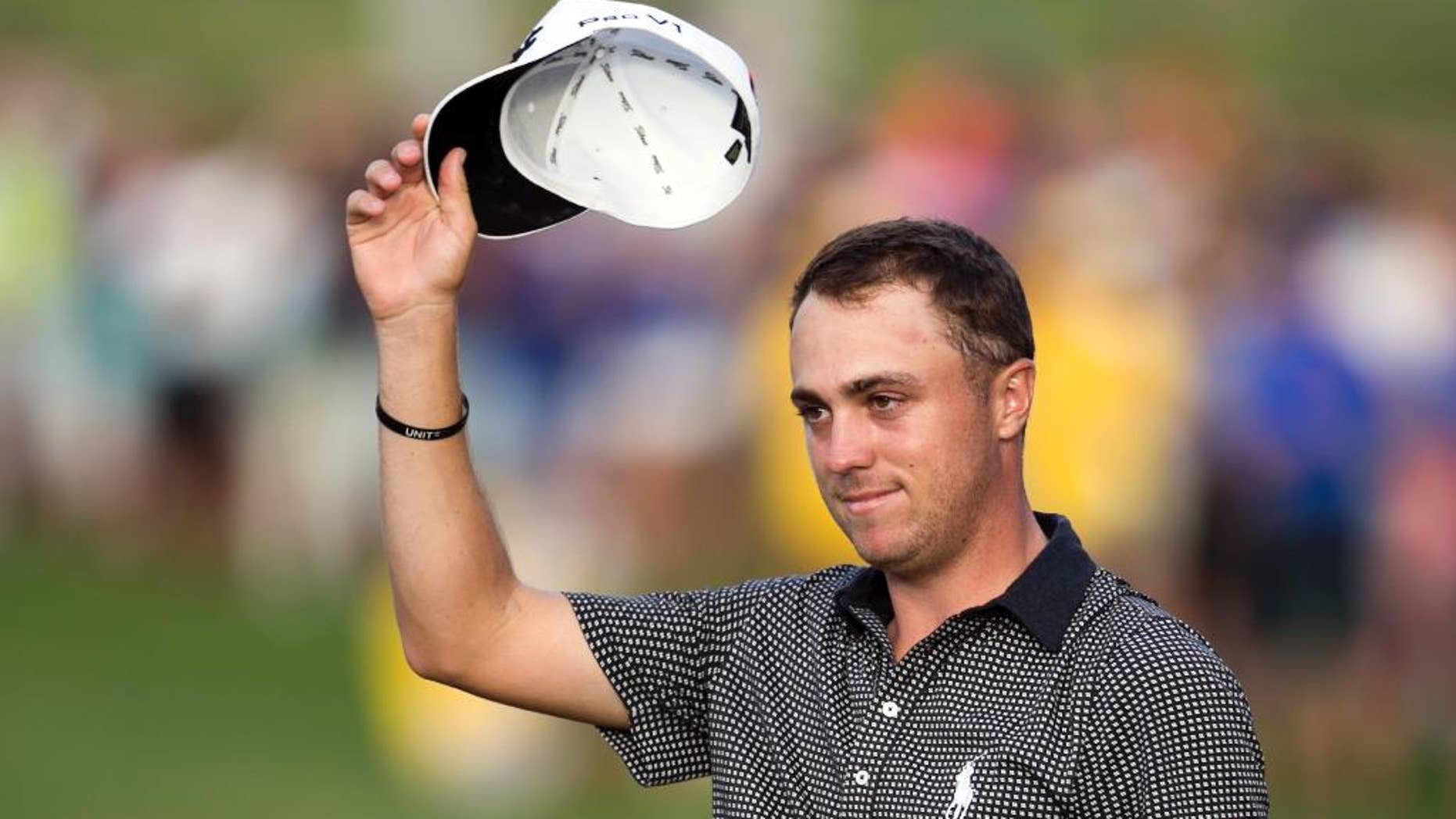 FILE - In this Jan. 15, 2017, file photo, Justin Thomas acknowledges to the gallery after winning the Sony Open golf tournament in Honolulu. Thomas is set to play in the Waste Management Phoenix Open this week, coming off a two-break after a dominating Hawaiian sweep. (AP Photo/Marco Garcia, File)