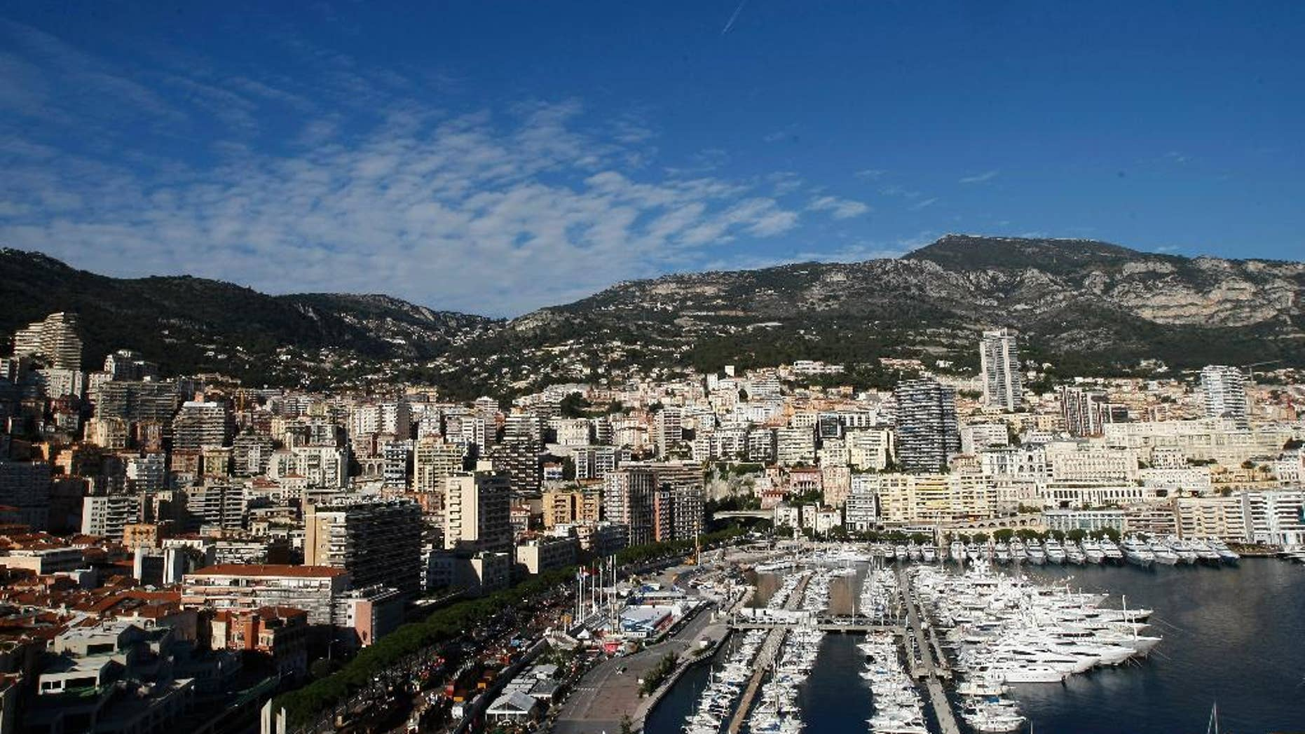 FILE - This Dec.12, 2014 file photo shows the Monaco principality and its yachts docked in the harbour.  Monaco's government says it's investigating how an alleged vast oil corruption scandal involving a Monaco-based company long went unnoticed, even though the principality has opened up its financial sector and cracked down on tax dodging. (AP Photo/Claude Paris, File)