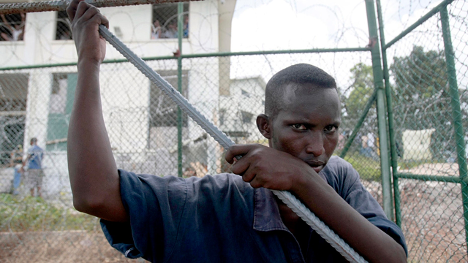 A Somali inmate detained last year during an anti-piracy operation conducted by Seychelles Coast Guard pauses as he works at the incarceration block in Montagne Posee near Victoria, Seychelles. Piracy attacks worldwide reached an all-time high in 2011, becoming more violent and lucrative than ever in the process. (AP)
