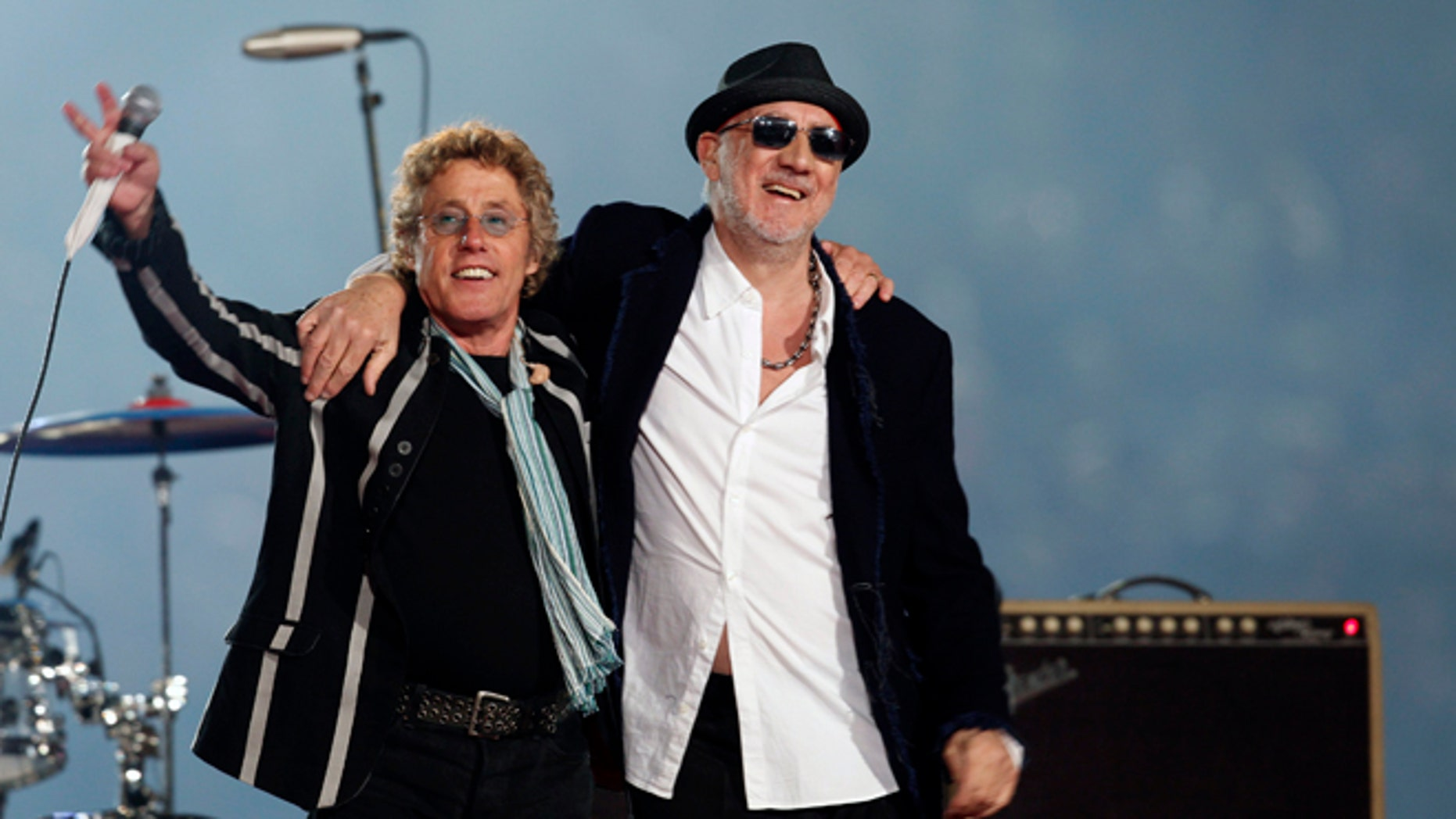 The Who guitarist Pete Townshend (r., with bandmate Roger Daltrey) says he downloaded child porn in a bid to follow the money trail. (AP)