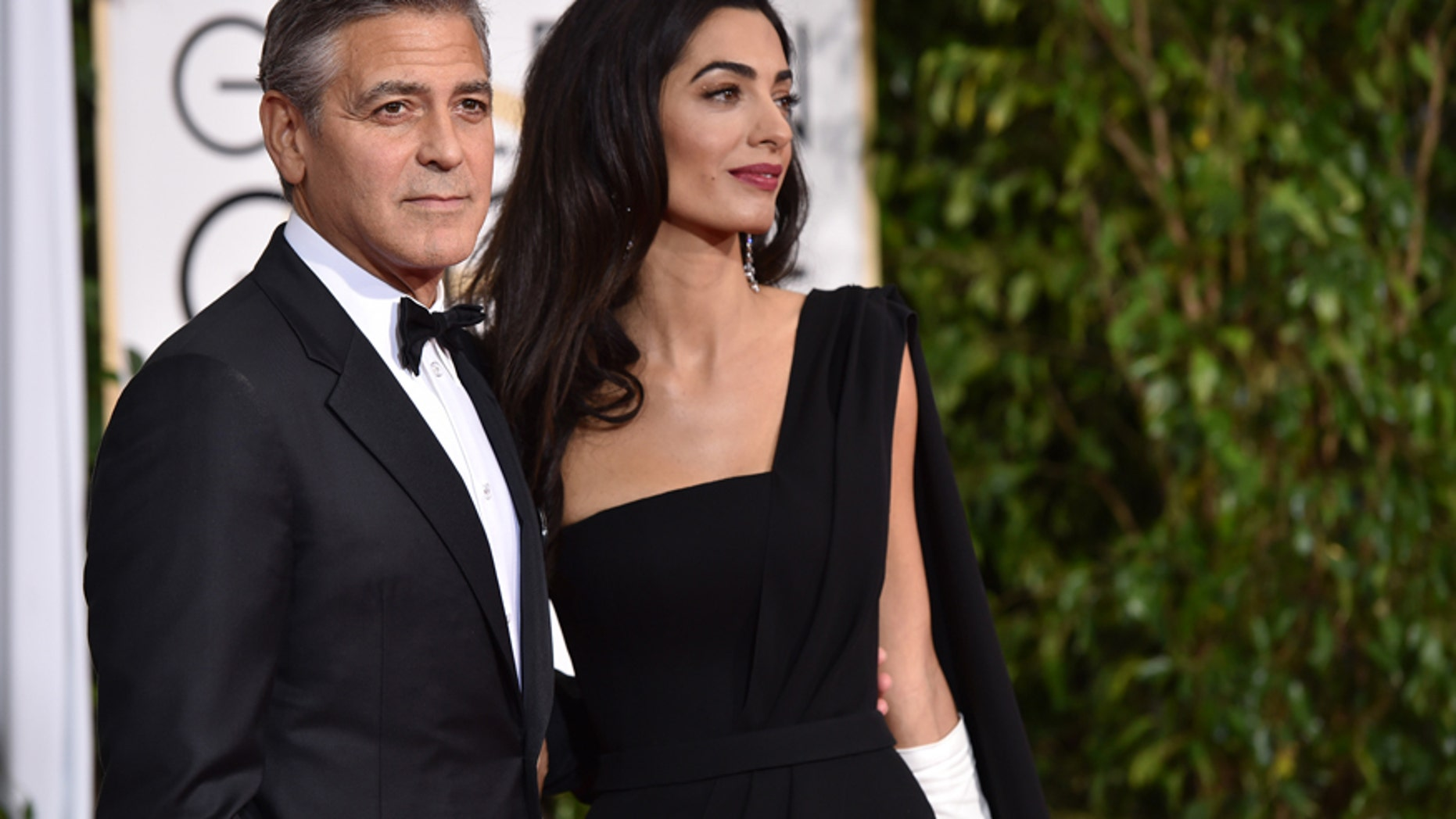 George Clooney, left, and Amal Clooney arrive at the 72nd annual Golden Globe Awards at the Beverly Hilton Hotel on Sunday, Jan. 11, 2015, in Beverly Hills, Calif.