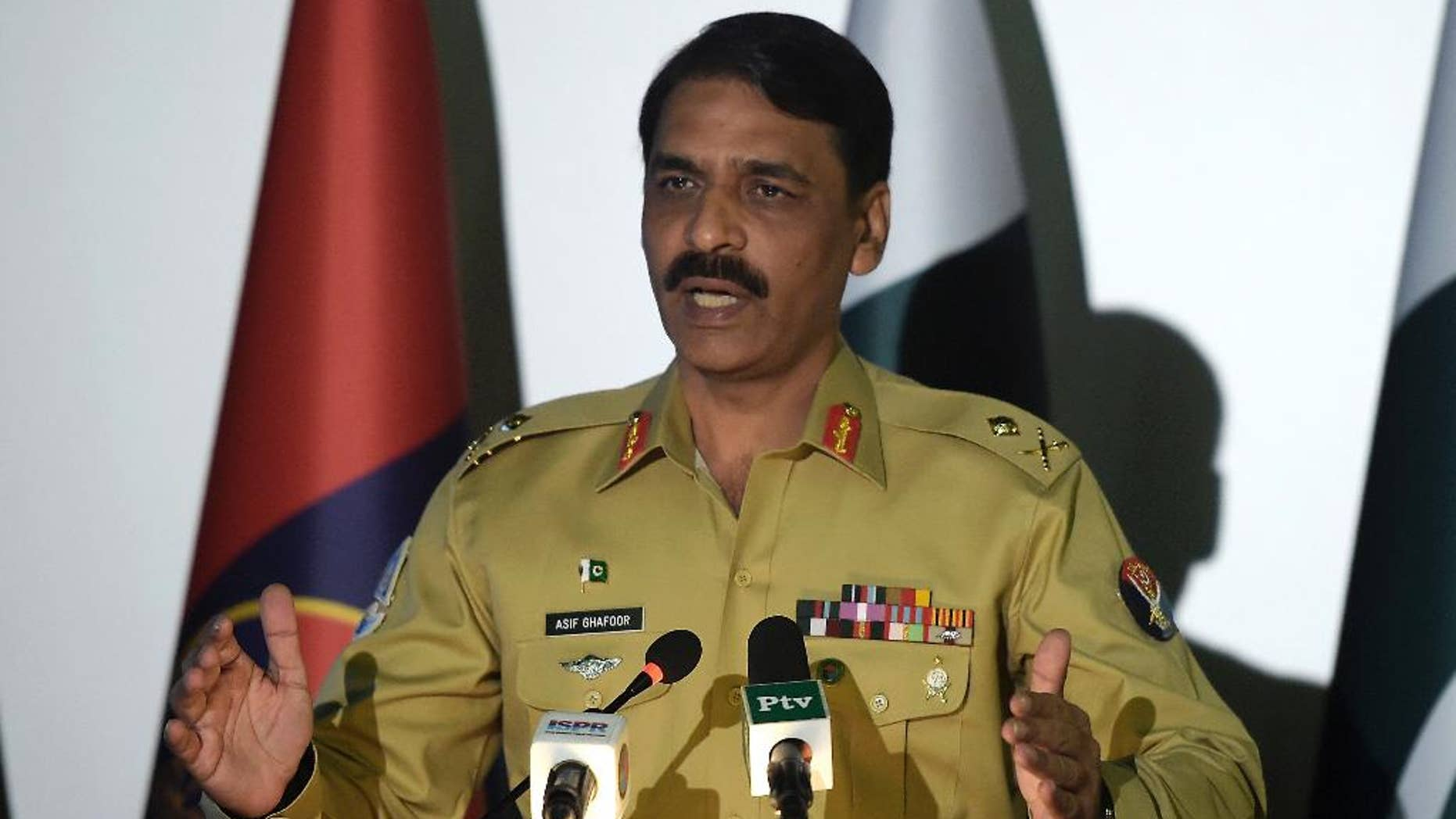 FILE - In this Monday, April 17, 2017 file photo Pakistan's army spokesman Maj. Gen. Asif Ghafoor addresses a news conference in Rawalpindi, Pakistan. Pakistan's military backed off on Wednesday, May 10  after publicly questioning the prime minister's decision to sack an adviser over an explosive newspaper article alleging a rift between the country's civilian government and the military. (AP Photo/Anjum Naveed,file)