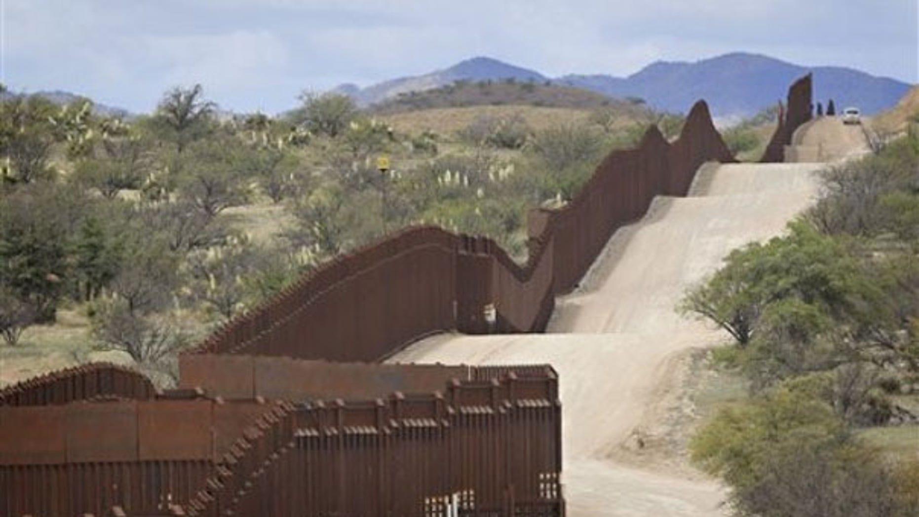 April 22: A Customs and Border Patrol agent patrols along the border in Nogales, Ariz. (AP Photo)