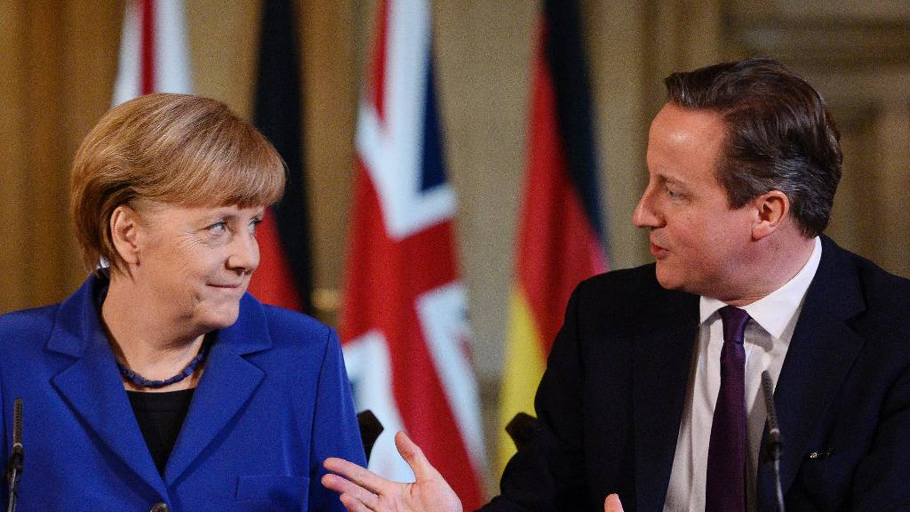 """FILE - In this Feb. 27, 2014 file picture British Prime Minister, David Cameron, speaks with  German Chancellor Angela Merkel during their joint press conference inside 10 Downing Street in London. Chancellor Angela Merkel's spokesman says Germany wants Britain to remain an """"active and committed"""" European Union member but is insisting the principle of free movement of workers within the bloc isn't negotiable. British Prime Minister David Cameron, facing political pressure from the rise of Britain's anti-EU UKIP party, wants to take steps to limit the level of migration from the EU into Britain. German weekly Der Spiegel reported Sunday Nov. 2, 2014 , without identifying sources, that German officials could envision giving up efforts to keep Britain in the EU if Cameron insists on limits.   (AP Photo/ Facundo Arrizabalaga, Poo,Filel)"""