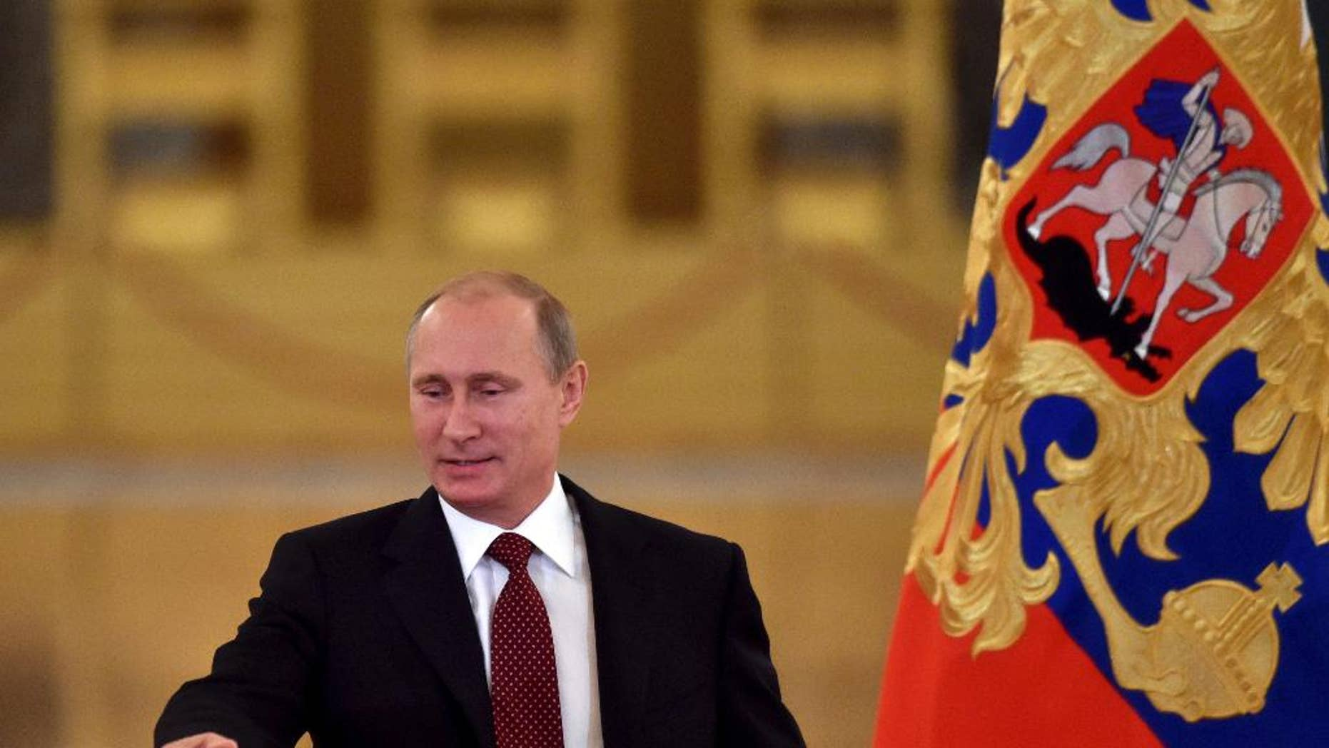 Russian President Vladimir Putin arrives prior to heading the Human Rights Council in Moscow's Kremlin, Russia, Tuesday, Oct. 14, 2014. (AP Photo/Kirill Kydryavtsev, Pool)