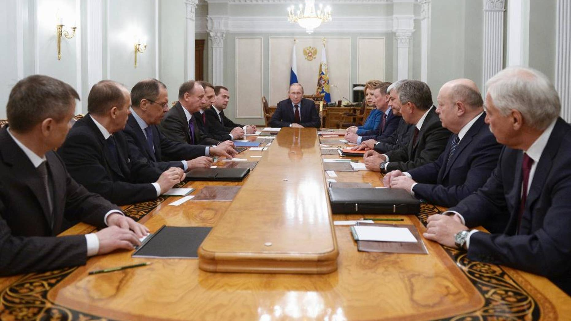Russian President Vladimir Putin, center, chairs a Security Council meeting in the Novo-Ogaryovo residence outside Moscow, Russia, Friday, Jan. 30, 2015. (AP Photo/RIA-Novosti, Alexei Nikolsky, Presidential Press Service)