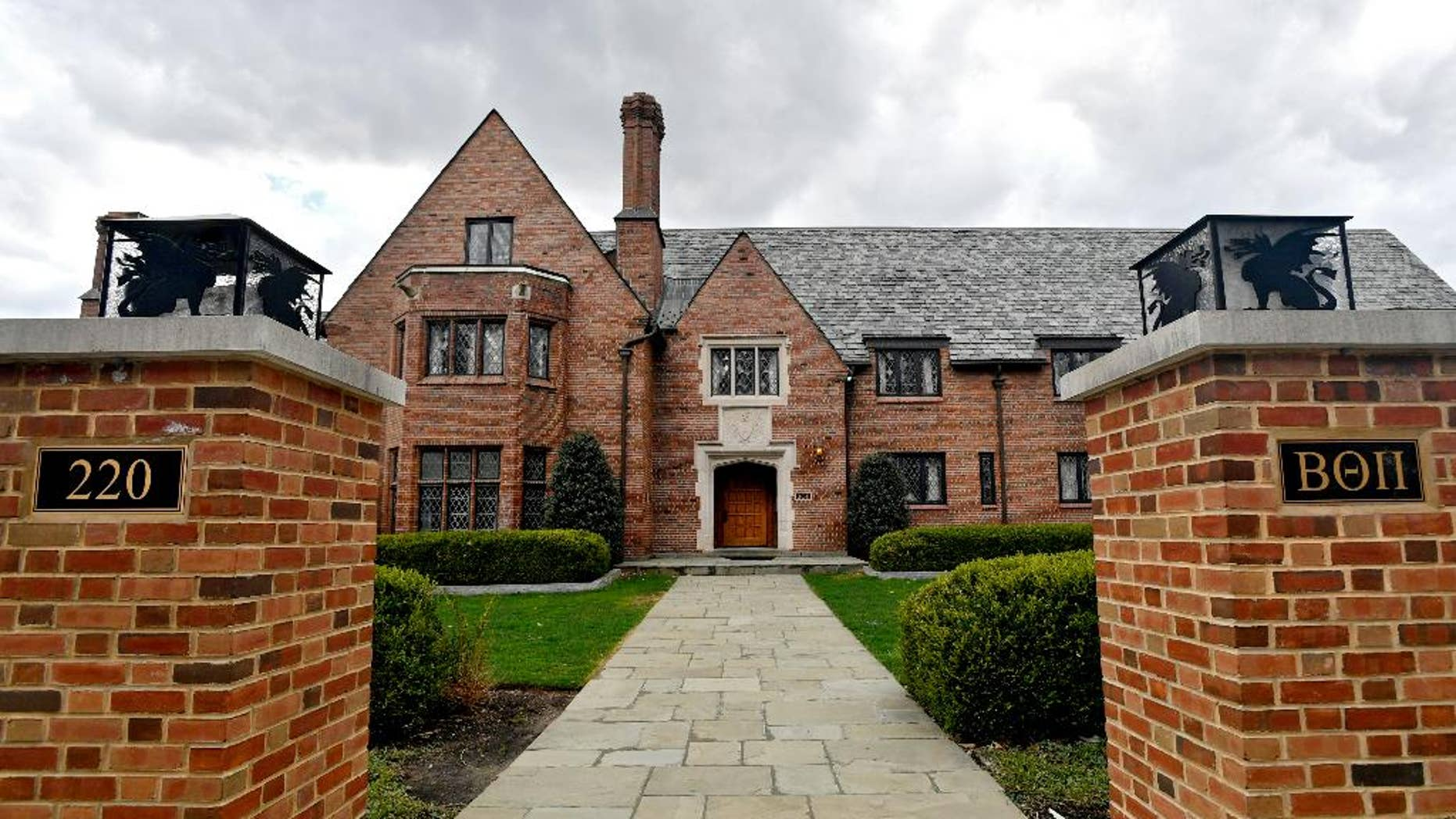 The former Penn State Beta Theta Pi currently sits empty on Burrowes Road after being shut down.  A Penn State fraternity pledge died after stumbling and falling several times with toxic levels of alcohol in his body and suffered for hours with severe injuries while his friends failed to summon help, authorities said Friday, May 5, 2017, in announcing criminal charges against the fraternity and 18 of its members.(Abby Drey/Centre Daily Times via AP)