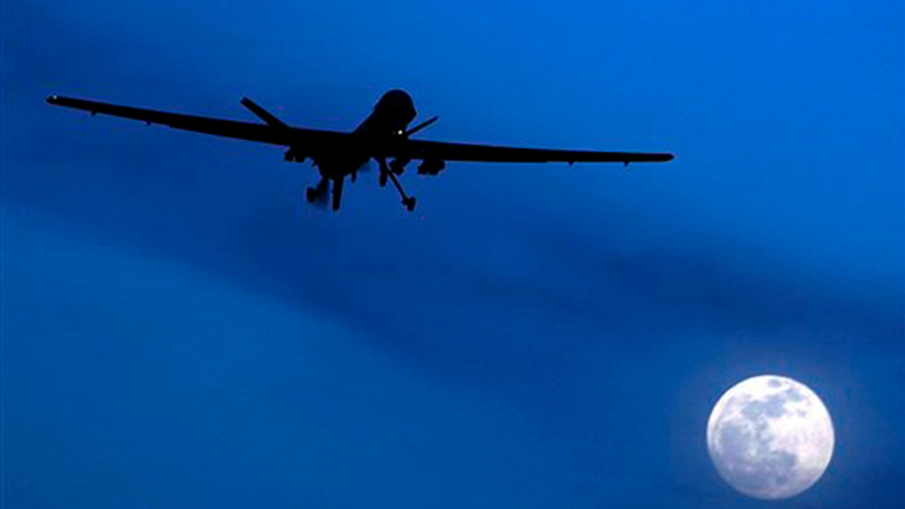 Jan. 31, 2010: This file photo shows a U.S. Predator drone flies over the moon above Kandahar Air Field, southern Afghanistan.
