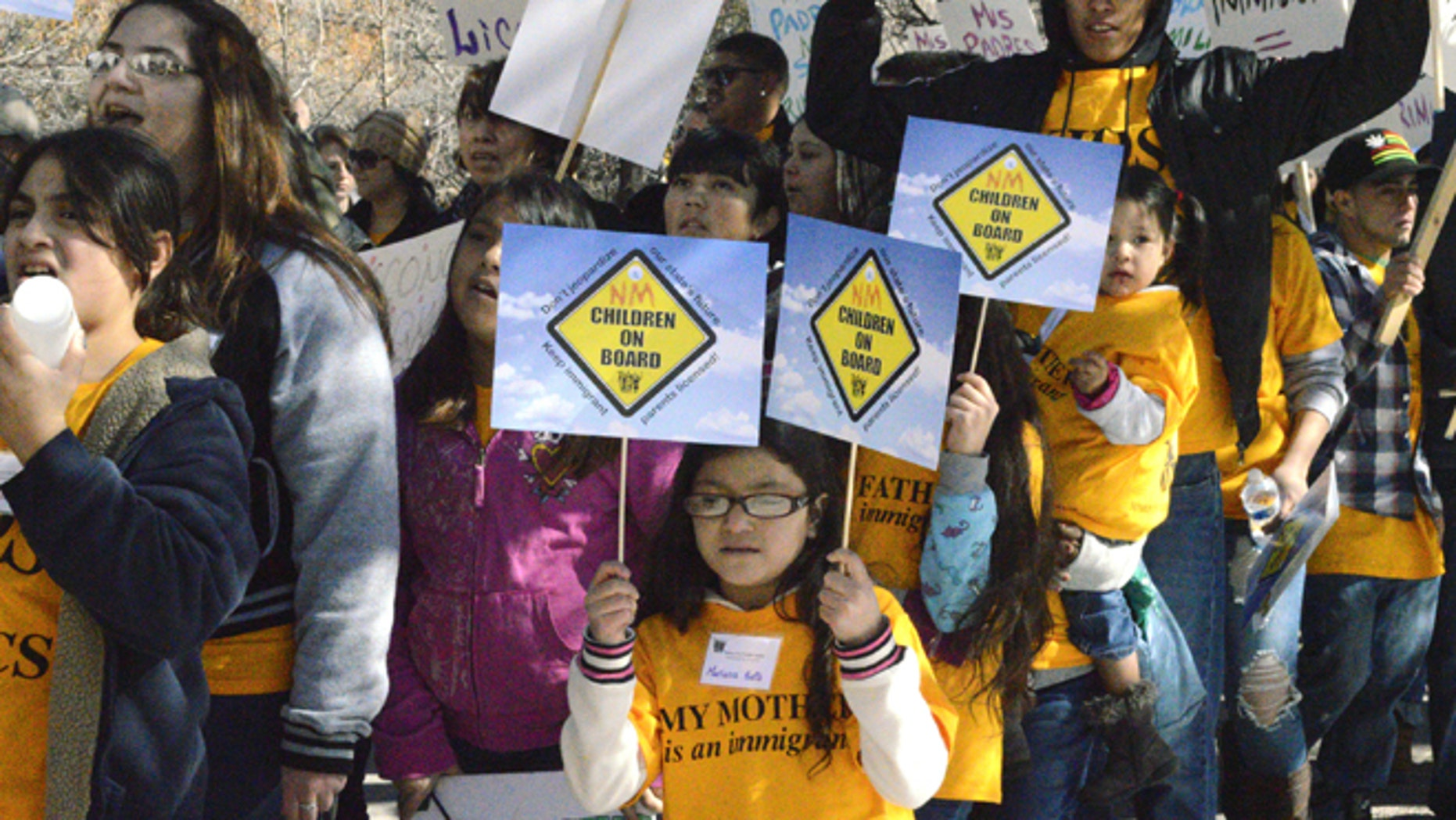 Thousands of immigrant advocates rally at the State Capitol to protest a proposal aimed at repealing a New Mexico law that allows immigrants in the country illegally to obtain driver's licenses Monday, Feb. 2, 2015, in Santa Fe, N.M. (AP Photo/Russell Contreras)