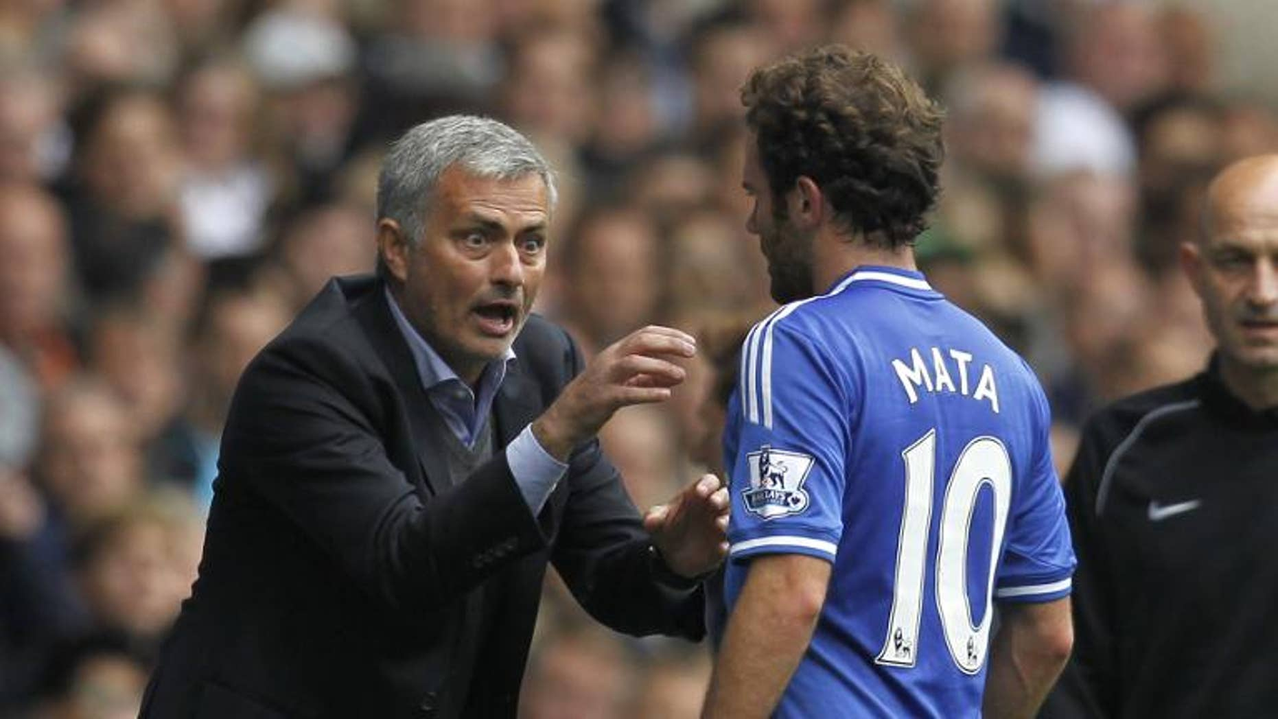 Chelsea's Portuguese manager Jose Mourinho (left) gestures to Juan Mata during a match with Tottenham Hotspur at White Hart Lane on September 28, 2013