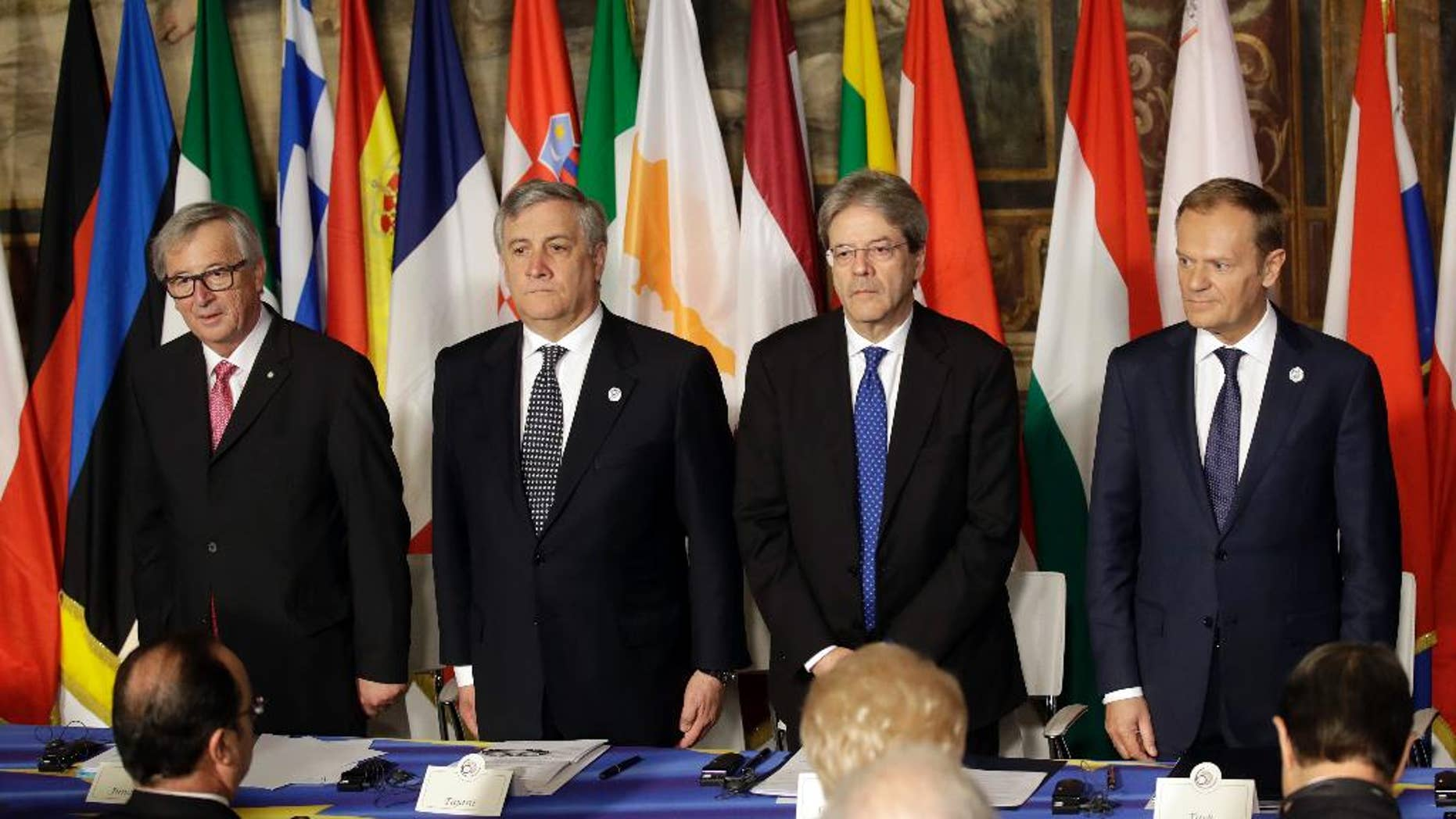 From left, European Commission President Jean-Claude Juncker, European Parliament President Antonio Tajani, Italian Prime Minister Paolo Gentiloni and European Council President Donald Tusk wait for the start of a meeting in the Orazi and Curiazi Hall at the Palazzo dei Conservatori during an EU summit in Rome on Saturday, March 25, 2017. European Union leaders were gathering in Rome to mark the 60th anniversary of their founding treaty and chart a way ahead following the decision of Britain to leave the 28-nation bloc. (AP Photo/Alessandra Tarantino)