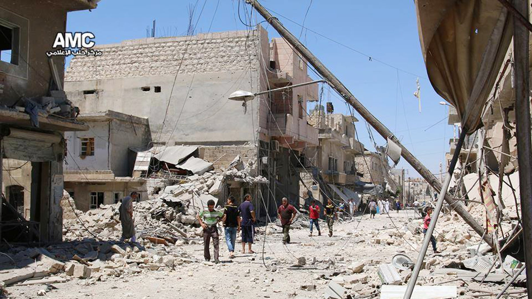 FILE - n this Wednesday, July. 27, 2016 photo, provided by the Syrian anti-government activist group Aleppo Media Center (AMC), shows Syrian citizens inspect damaged buildings after airstrikes hit Aleppo, Syria.