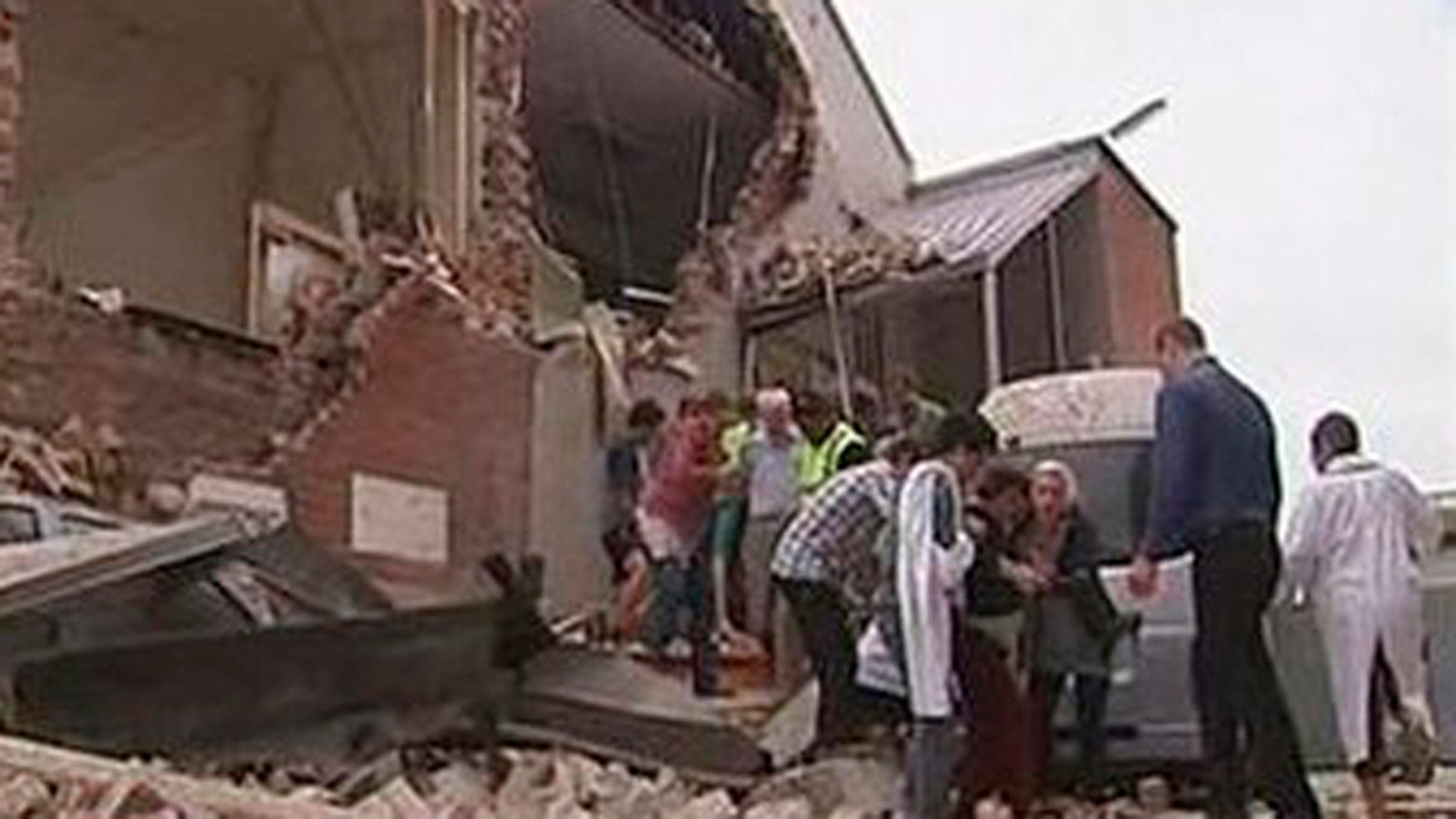 Feb. 22: People are evacuated from a damaged building after an earthquake in Christchurch, New Zealand.
