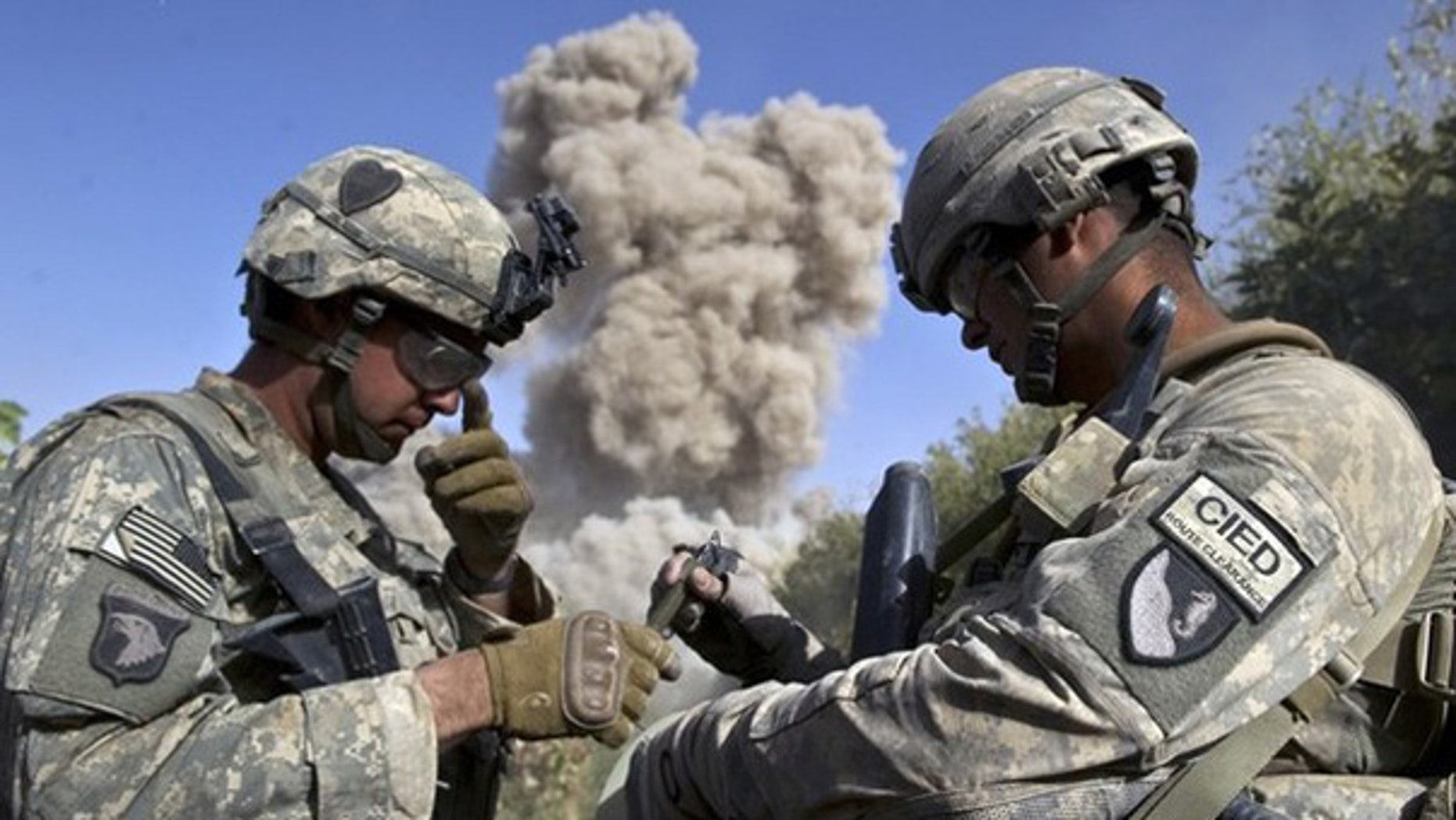 Oct. 25: U.S. soldiers blow up a building they believe the Taliban may use in Kandahar, Afghanistan.
