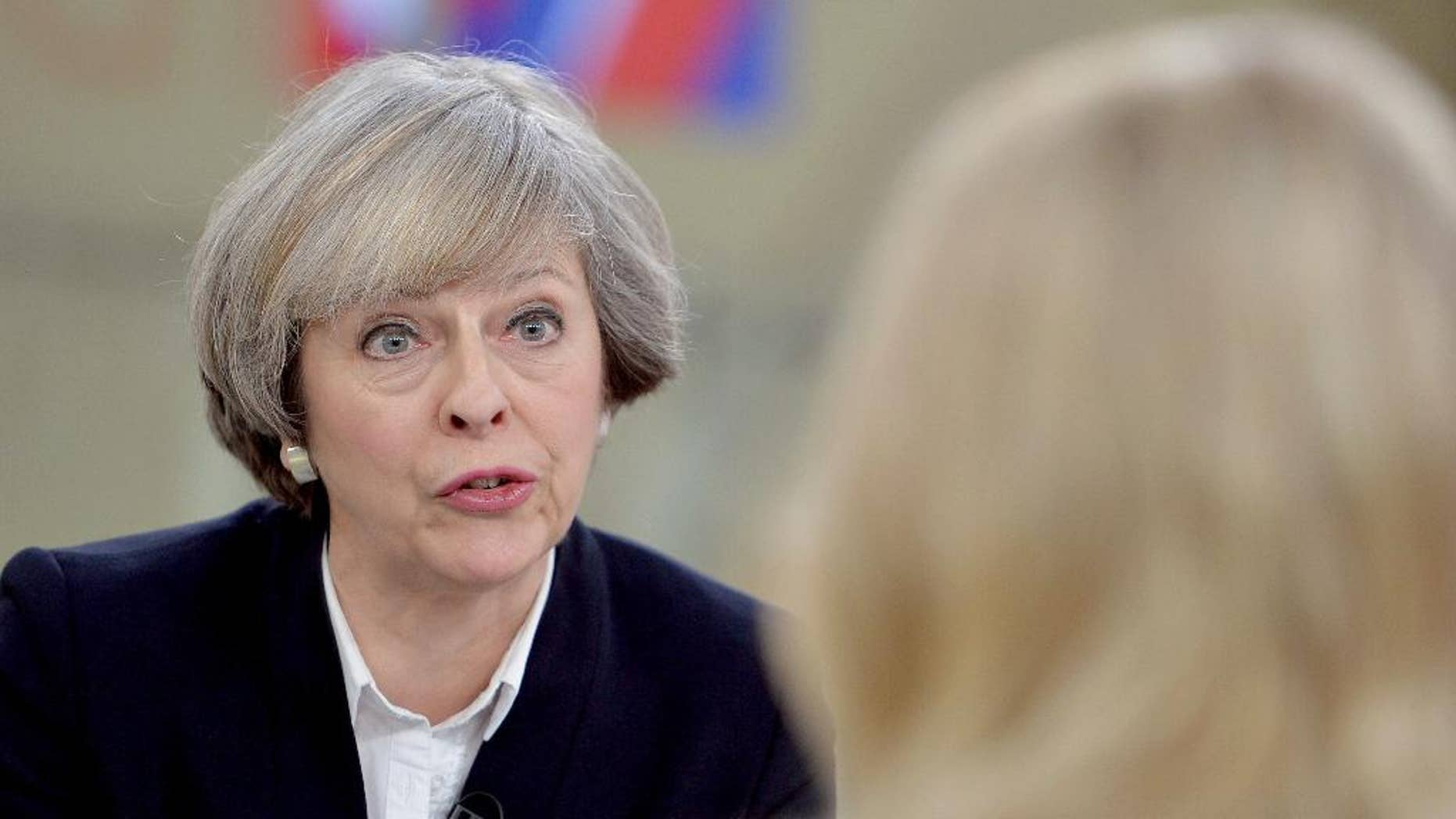 """Britain's Prime Minister Theresa May, left, is interviewed by Sophy Ridge for a television channel, in London, Sunday Jan.  8, 2017. May said Sunday she will announce details of Britain's European Union exit plans in the next few weeks, and denied a former diplomat's claim that the government is """"muddled"""" about Brexit. (John Stillwell/PA via AP)"""