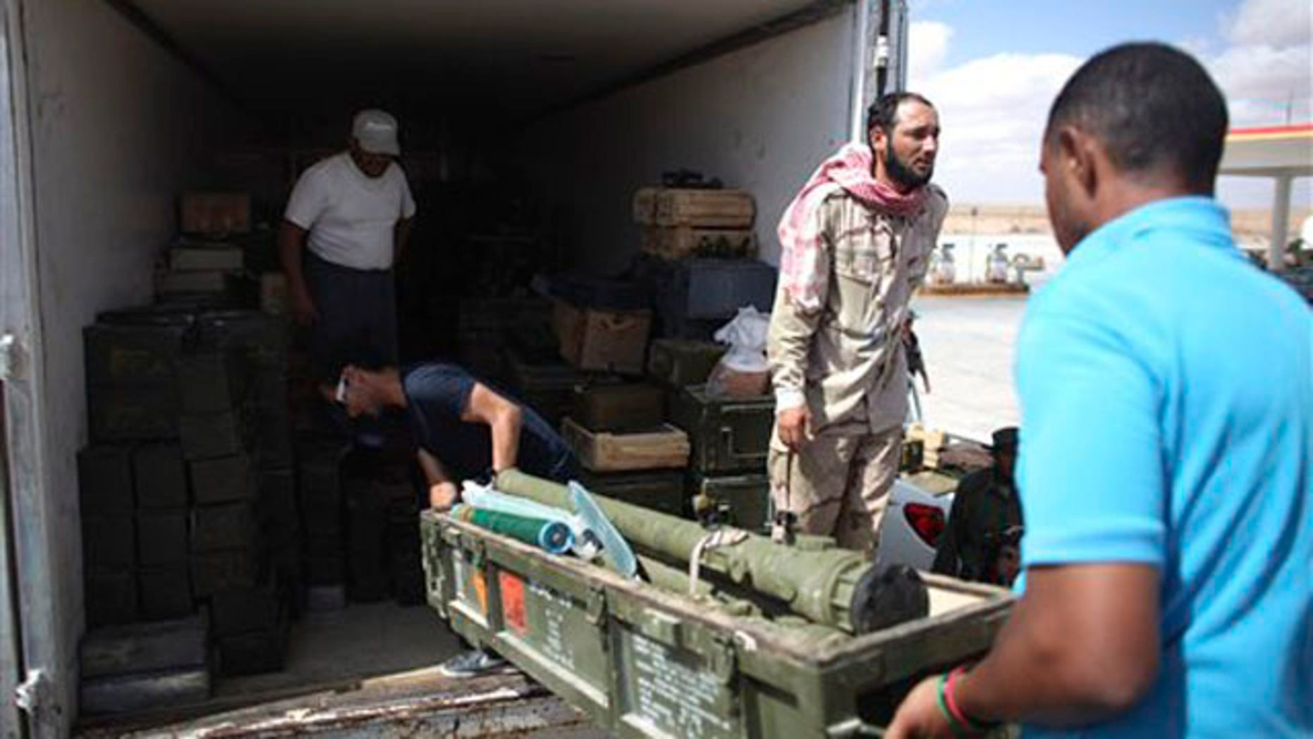 Rebels unload ammunition from a truck in Wish Tata, Libya, Friday, Sept. 9, 2011.
