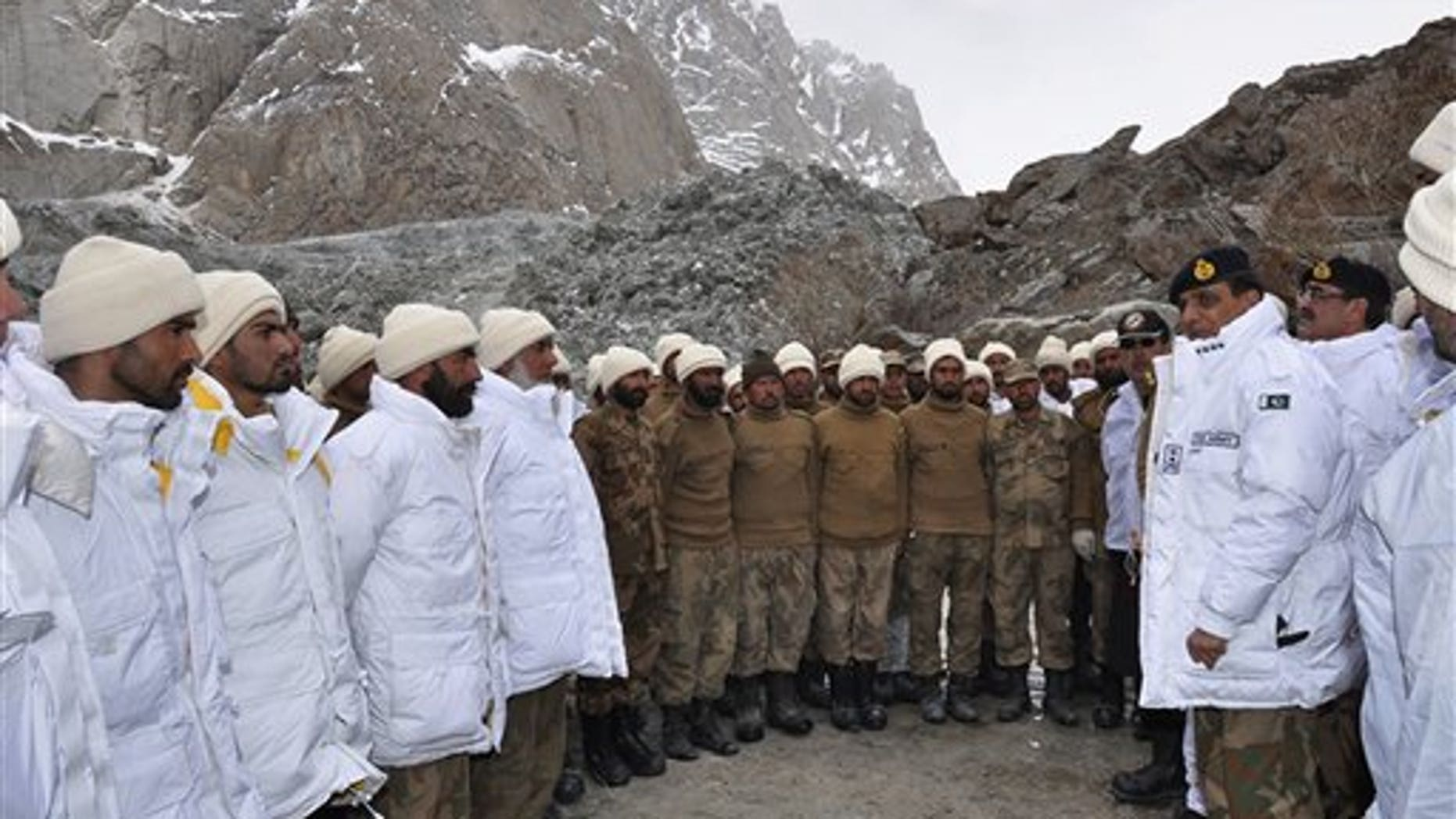 April 8, 2012: In this photo released by Inter Services Public Relations, Pakistan's army chief Gen. Ashfaq Parvez Kayani, second right, talks to soldiers during his visit to avalanche incident site in Siachen, in northern Pakistan.