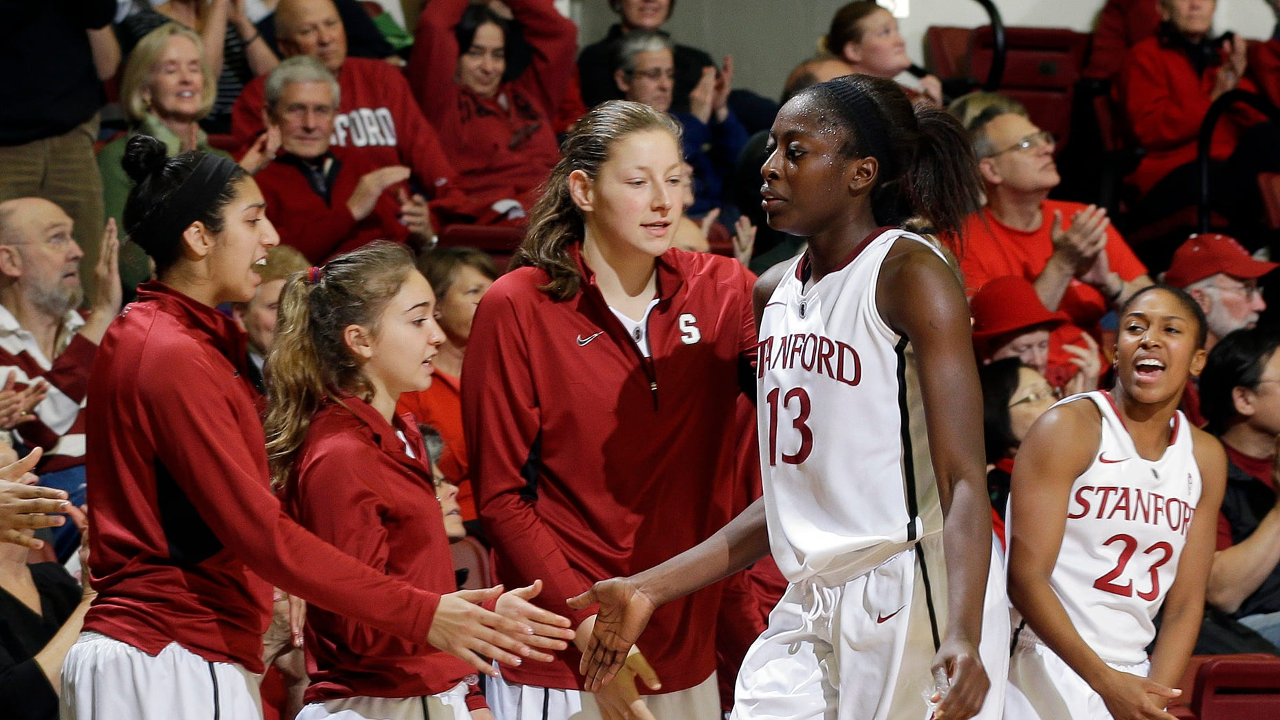 Stanford's Chiney Ogwumike (13) shakes hands with teammates on the bench against Pacific during the second half of an NCAA women's college basketball game in Stanford, Calif., Saturday, Dec. 15, 2012. (AP Photo/Marcio Jose Sanchez)