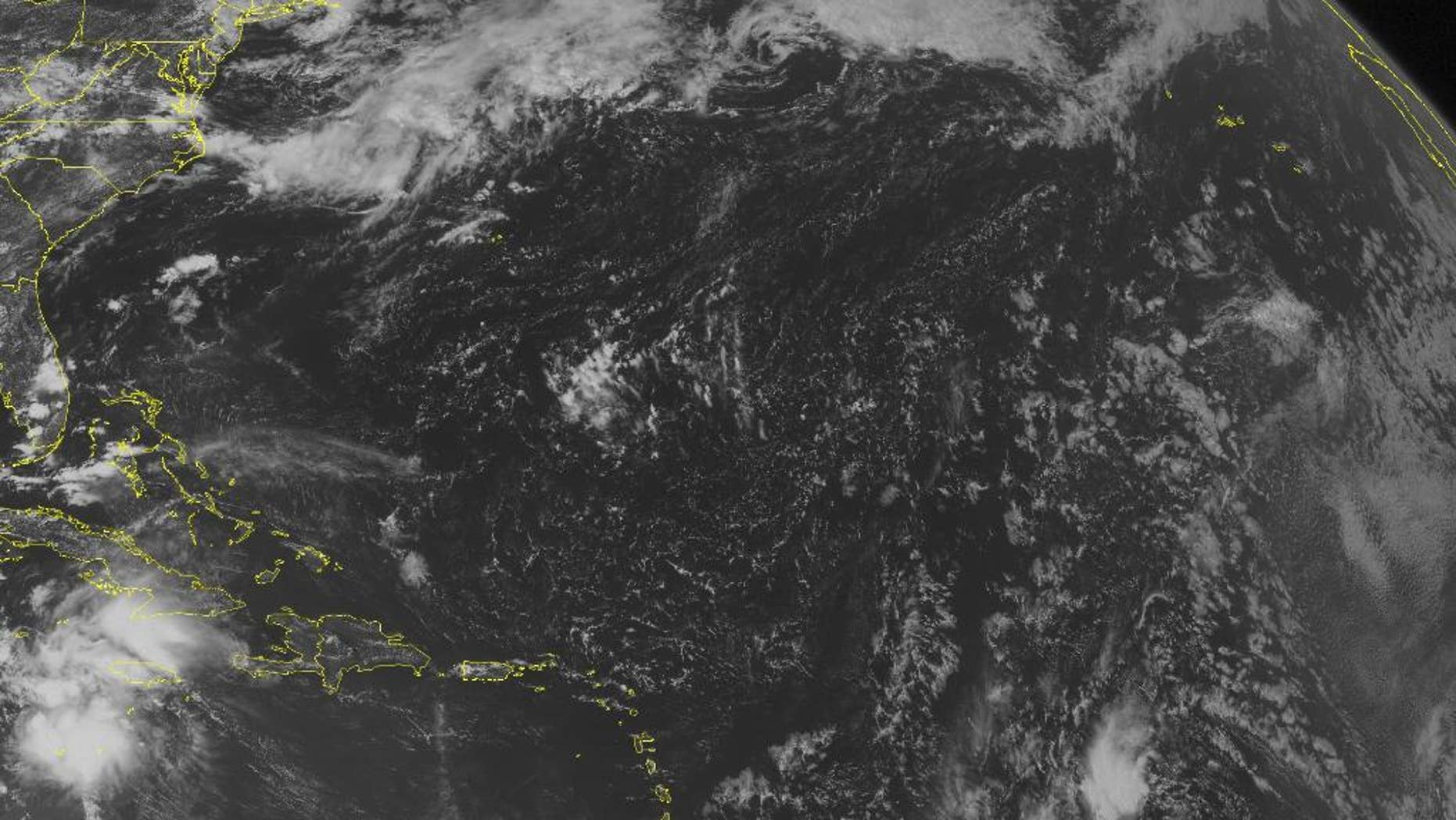 This NOAA satellite image taken Tuesday, Aug. 2, 2016 at 12:45 PM EDT shows Tropical Storm Earl 210 miles south of Grand Cayman.