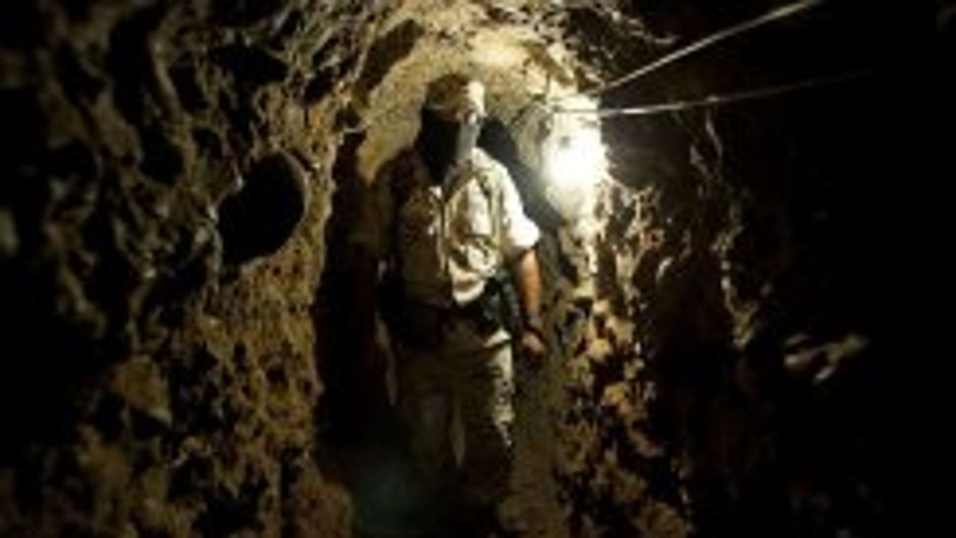 A soldier of the Mexican Army walks along a trans-border tunnel found near Tijuana Airport, in Tijuana, in the Mexican border with San Diego in the US, on August 11.