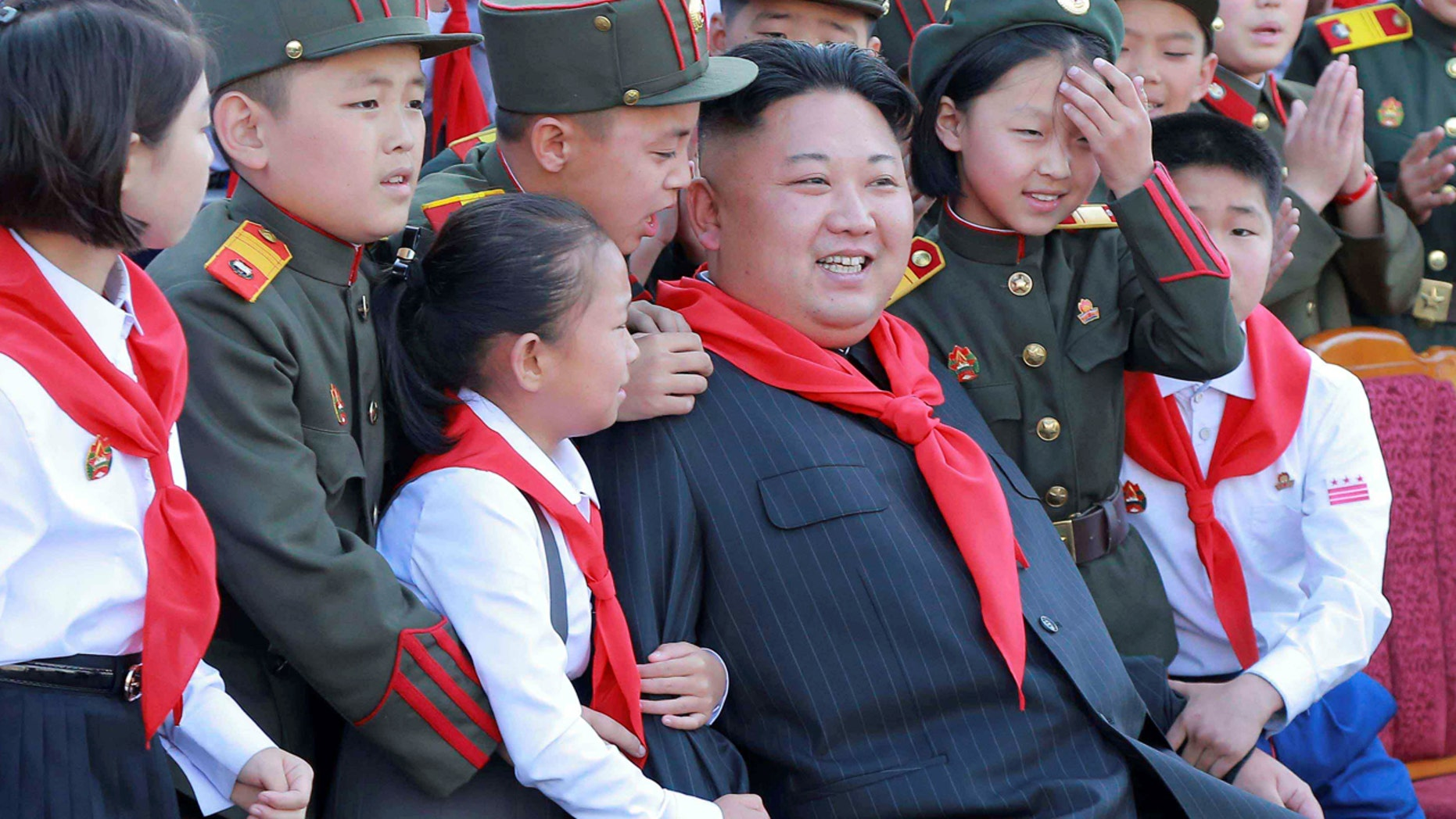 North Korean leader Kim Jong Un poses with participants during the 8th Congress of the Korean Children's Union