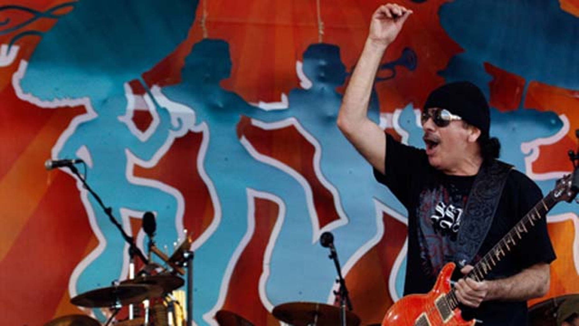 May 04, 2008: Carlos Santana performs during the New Orleans Jazz and Heritage Festival at the Fair Grounds Race Course in New Orleans, LA.
