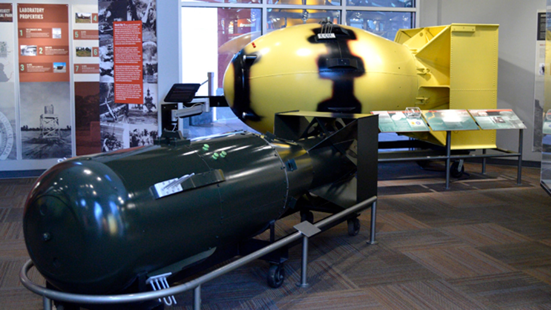 """This July 13, 2015 photo shows replicas of atomic bombs """"Little Boy,"""" left, and """"Fatman,"""" both dropped on Japan during World War II, sit at the Bradbury Science Museum in Los Alamos, N.M. Thursday, July 16, marks the 70th anniversary of the Trinity Test in southern New Mexico and comes amid renewed interest in the Manhattan Project thanks to new books, video oral histories and a WGN America television drama series. (AP Photo/Russell Contreras)"""