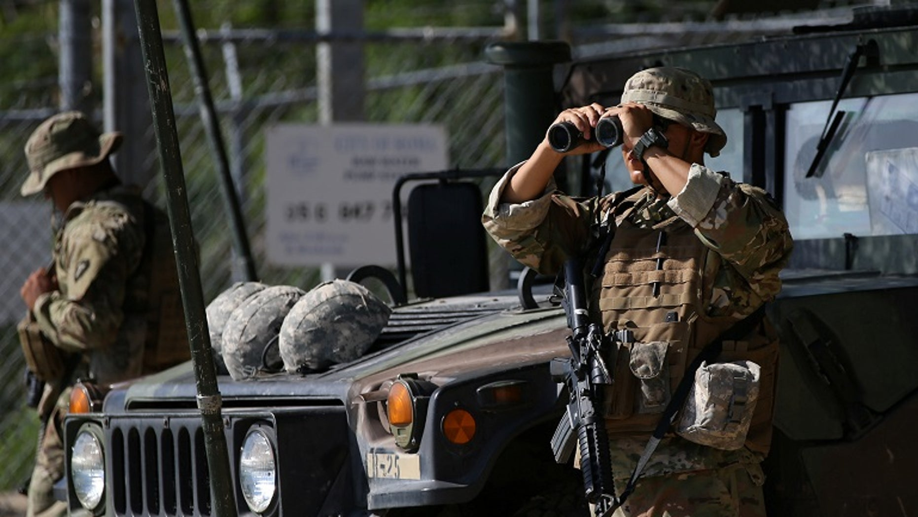 Members of the Texas National Guard patrol the Mexico-US border in April. The National Border Patrol Union called Trump's deployment to the border this year a 'waste,' despite earlier supporting the move.