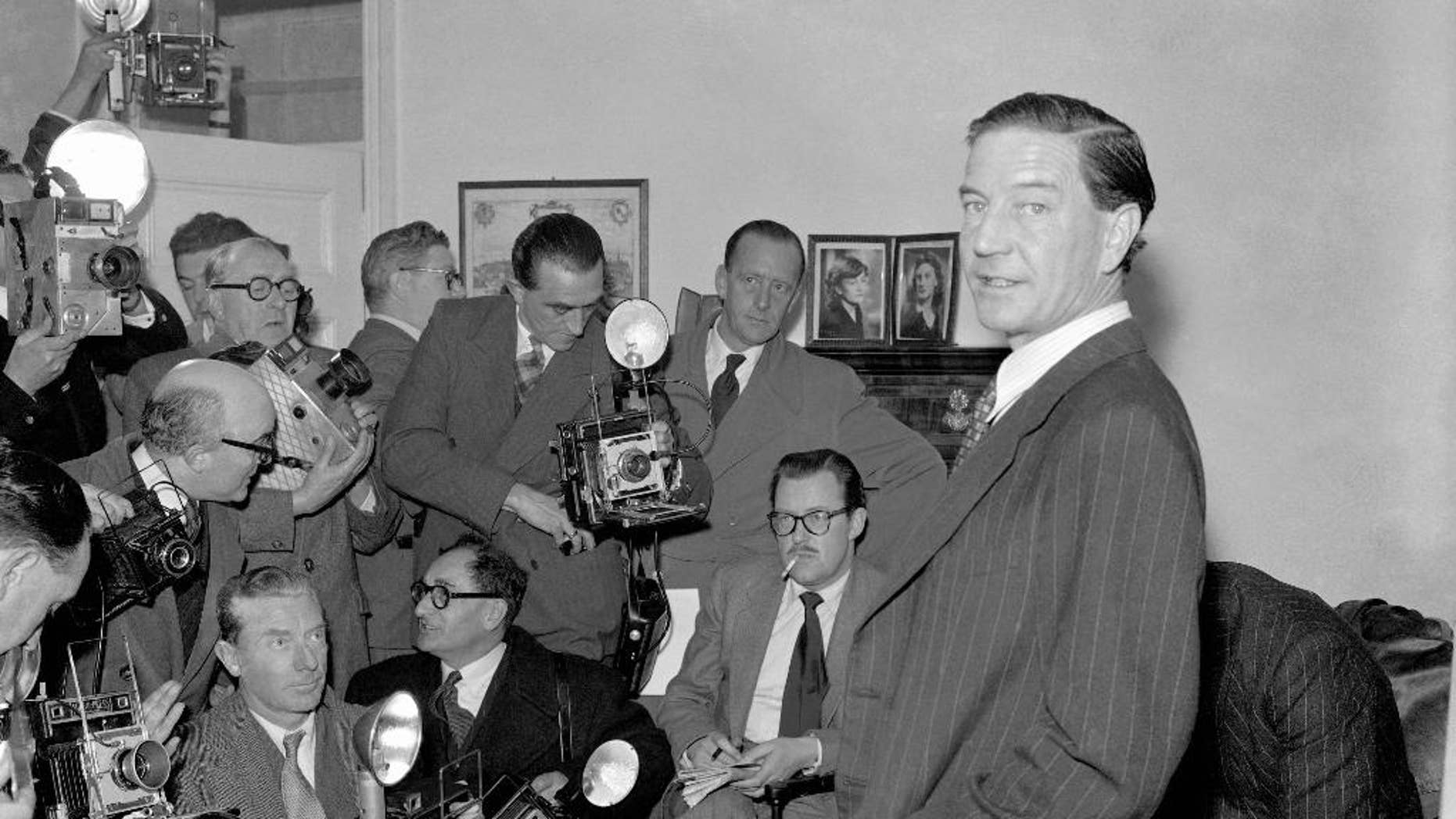 "FILE - In this file photo dated Nov. 8, 1955, former British diplomat who was at that time accused of spying for Russia, during a press conference at his parents' home in London on Nov. 8, 1955.  In a 1981 film posted online Monday April 4, 2016, by the BBC, notorious British spy Kim Philby is shown in newly uncovered footage addressing East German spies, ""comrades"", about his life as a double agent secretly helping the Soviet Union, in what is the closest thing to a full confession yet to surface. Philby died in 1988 in his adopted Soviet homeland. (AP Photo/FILE)"