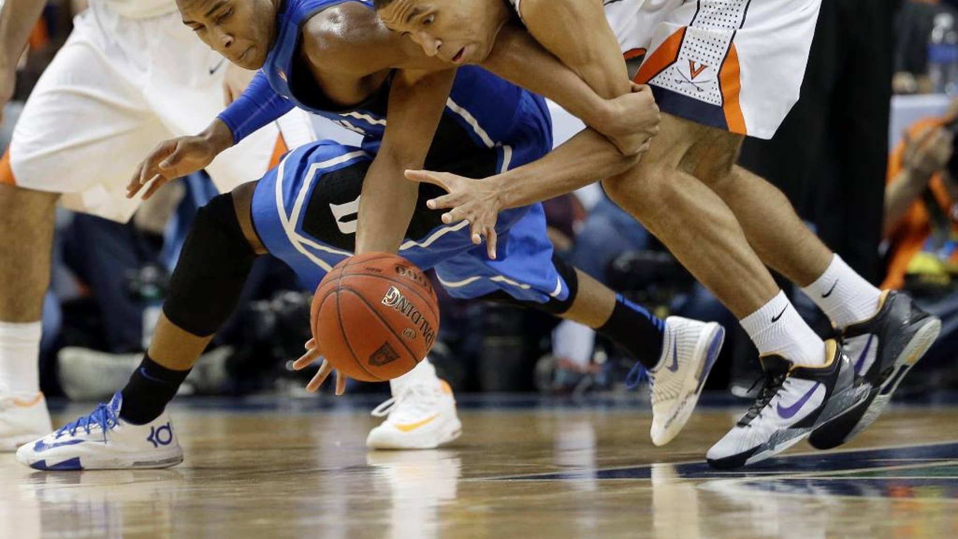Duke's Rasheed Sulaimon, left, and Virginia's Malcolm Brogdon, right, chase a loose ball during the first half of an NCAA college basketball game in the championship of the Atlantic Coast Conference tournament in Greensboro, N.C., Sunday, March 16, 2014. (AP Photo/Gerry Broome)
