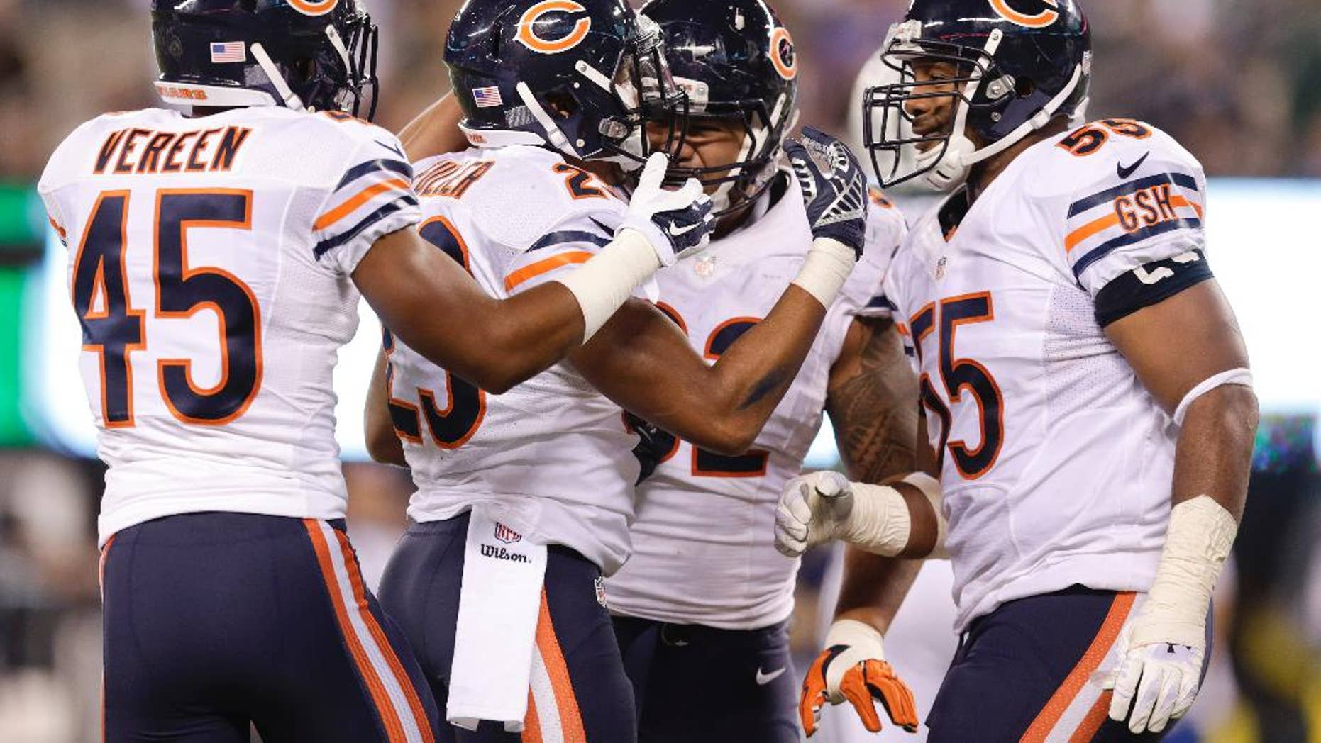 Chicago Bears cornerback Kyle Fuller (23) celebrates with teammates after intercepting a pass in the end zone against the New York Jets during the third quarter of an NFL football game, Monday, Sept. 22, 2014, in East Rutherford, N.J. (AP Photo/Julio Cortez)