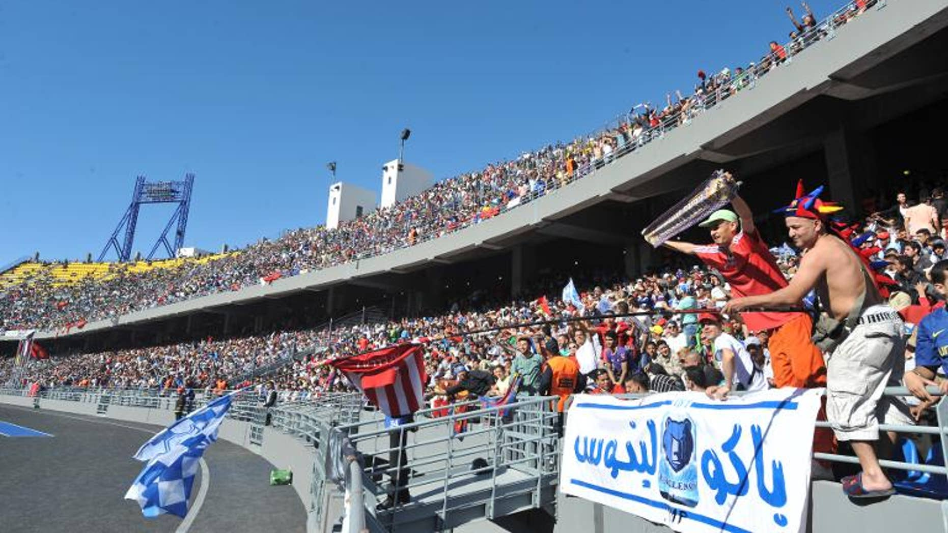 Supporters watch Athletico Madrid play Raja de Casablanca Tangier stadium on April 26, 2011
