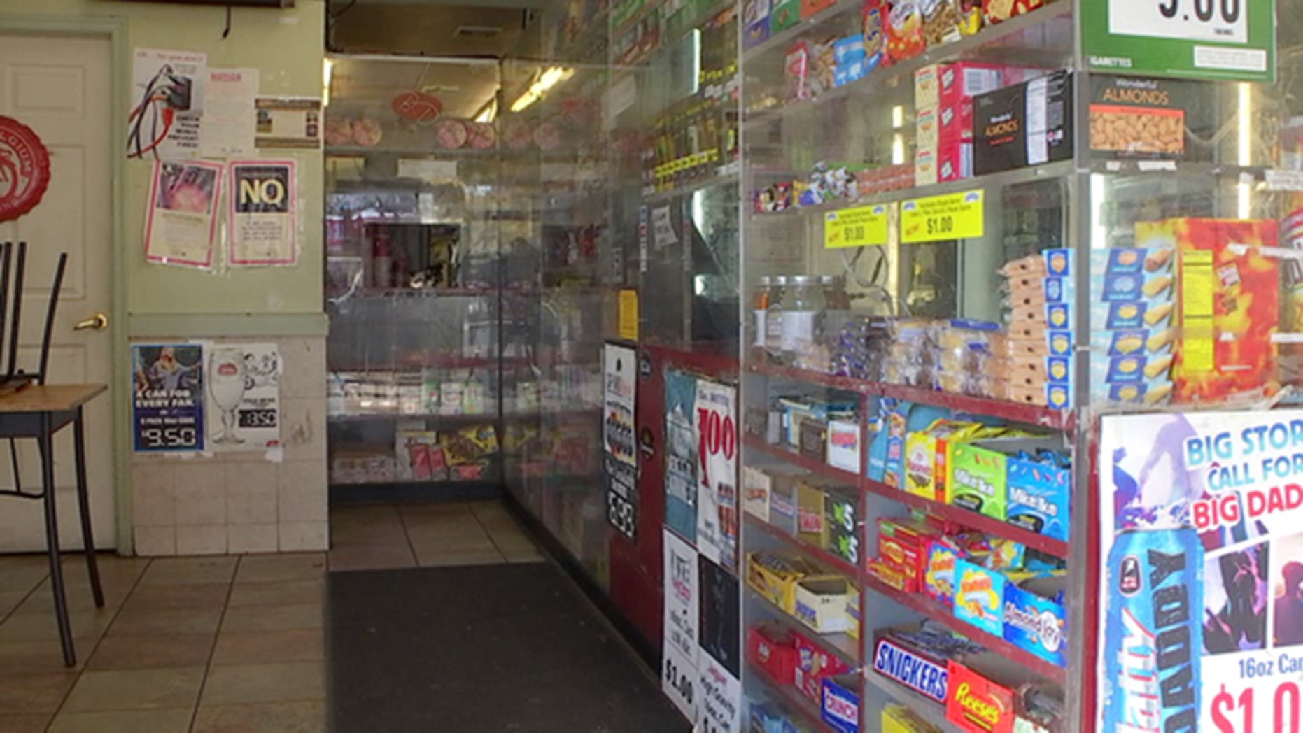 Bulletproof glass lines the counter of a deli in Philadelphia.