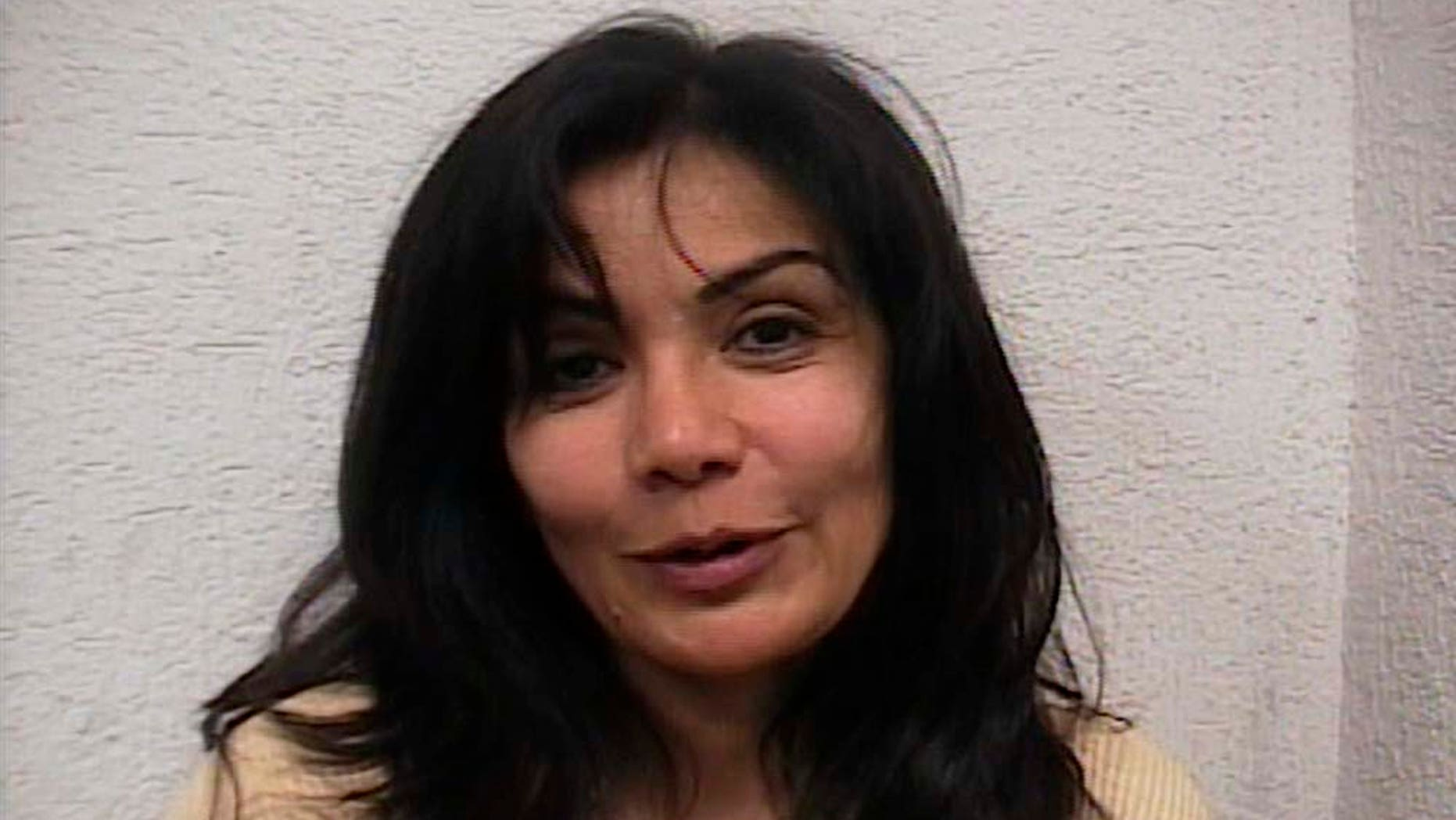 FILE - In this Sept. 28, 2007 file photo released by the Mexican Attorney General's Office, or PGR, Sandra Avila Beltran, dubbed the Queen of the Pacific, smiles after she was arrested by federal agents outside a restaurant in southern Mexico City.  Mexico City's prison authority says a doctor was improperly admitted to Santa Martha Acatitla women's lockup in January to give a Botox injection to Beltran, a purported top decision-maker in the Sinaloa cartel. (AP Photo/PGR, File)