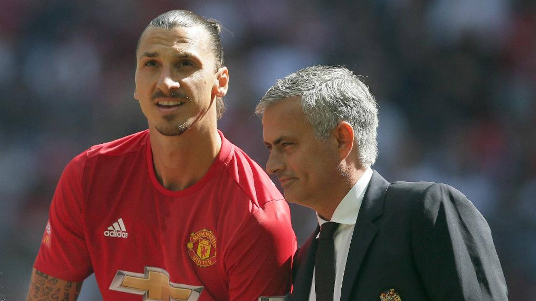 Manchester United manager Jose Mourinho, right, with Manchester United's Zlatan Ibrahimovic during the Community Shield soccer match between Leicester and Manchester United at Wembley stadium in London, Saturday April 9, 2016. (AP Photo/Tim Ireland)