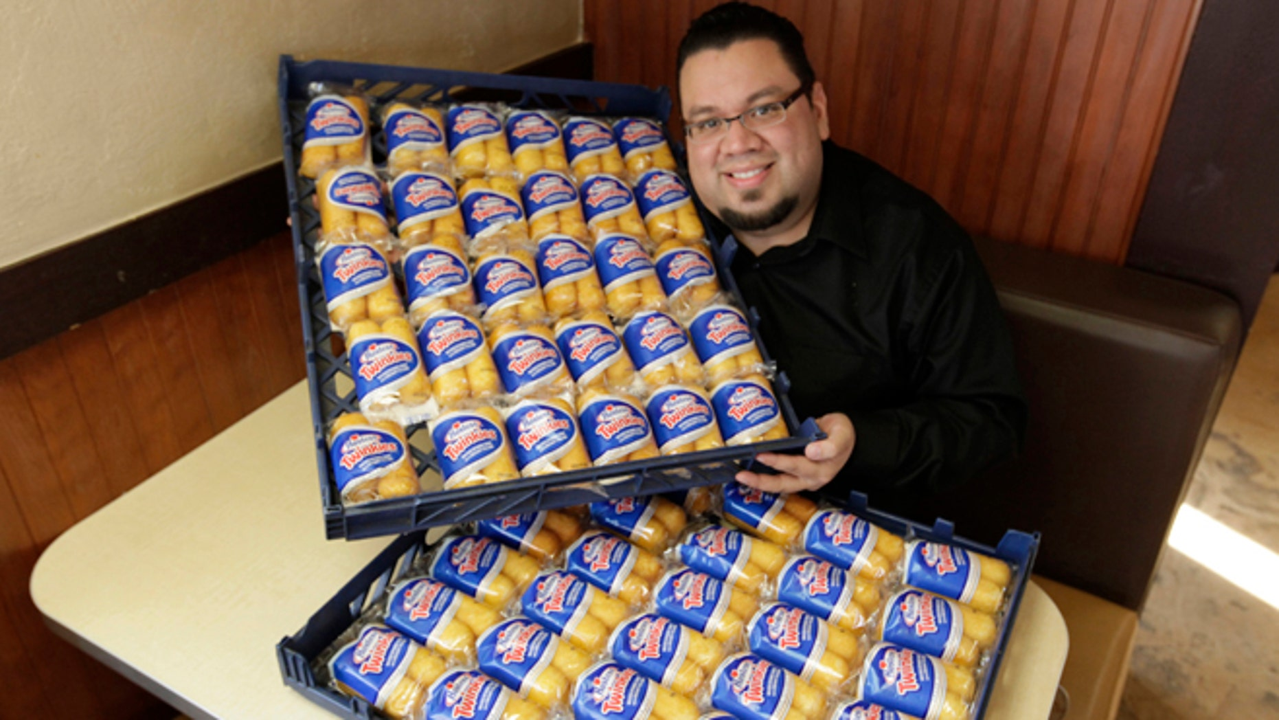 Dec. 5, 2012: Andres DeLeon of Baby's Steak & Lemonade in Orland Park, Ill, poses with a large supply of Hostess Twinkies at his restaurant.