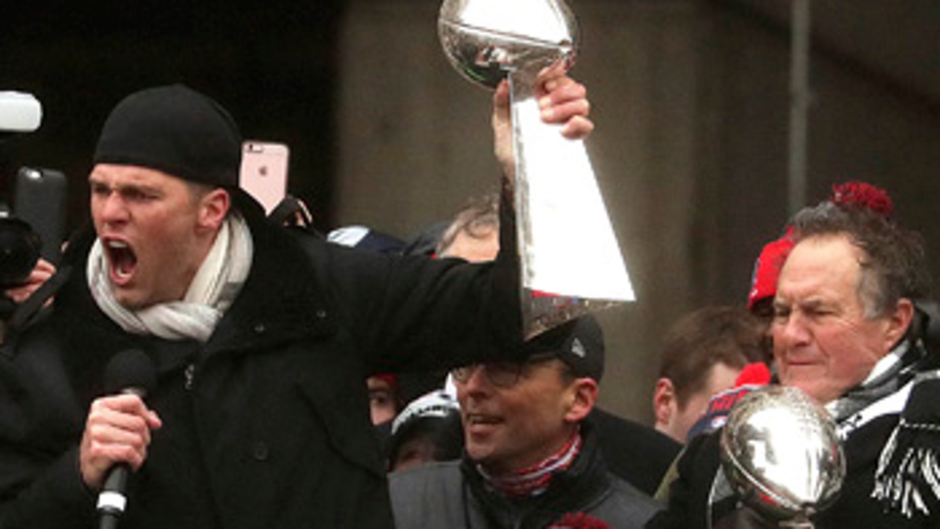 New England Patriots quarterback Tom Brady and head coach Bill Belichick hold Super Bowl trophies during a rally Tuesday, Feb. 7, 2017, in Boston to celebrate Sunday's 34-28 win over the Atlanta Falcons in the NFL Super Bowl 51 football game in Houston.  (Barry Chin /The Boston Globe via AP, Pool)