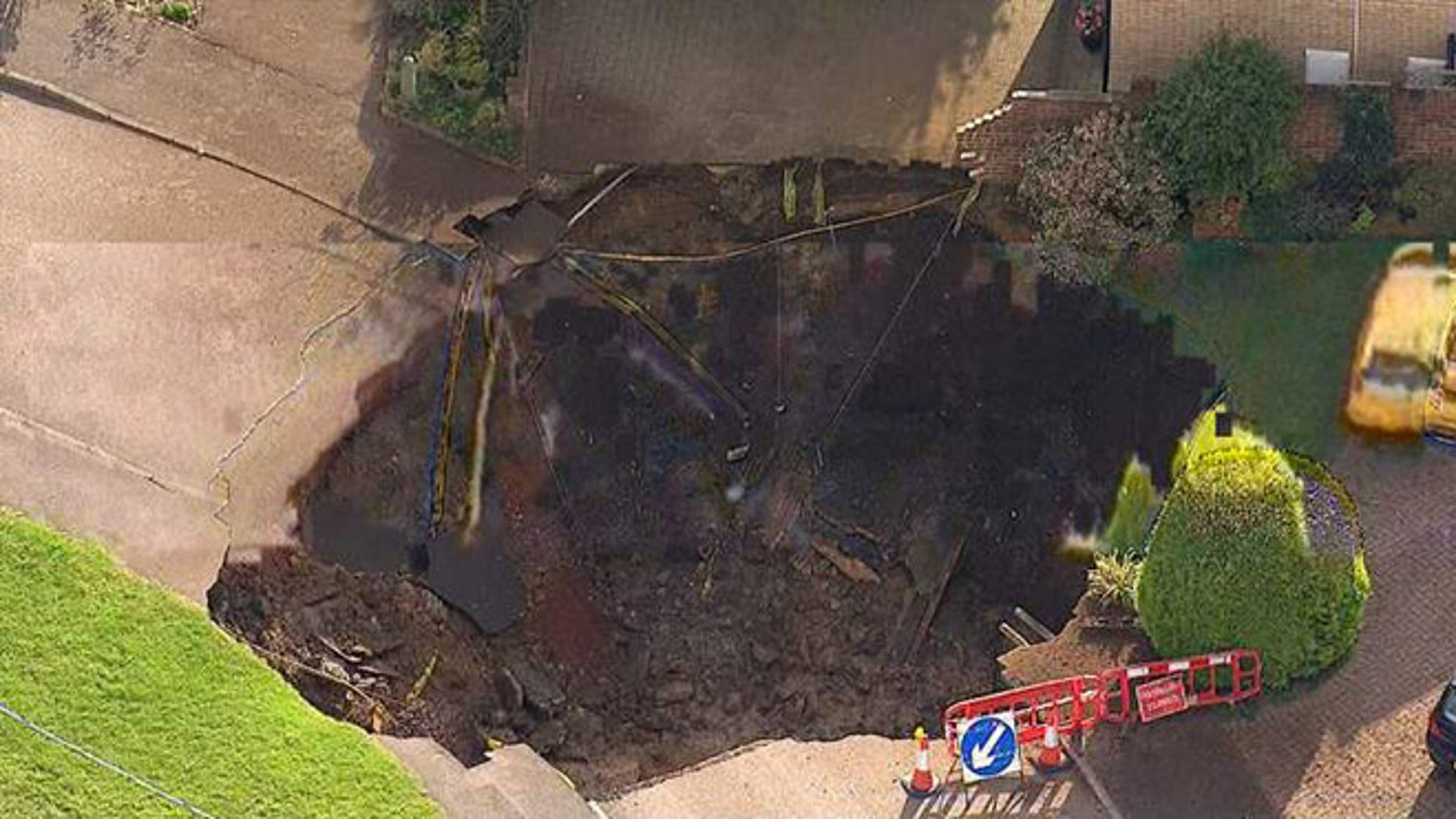 A sinkhole in St Albans, UK, has cut off more than 50 homes.