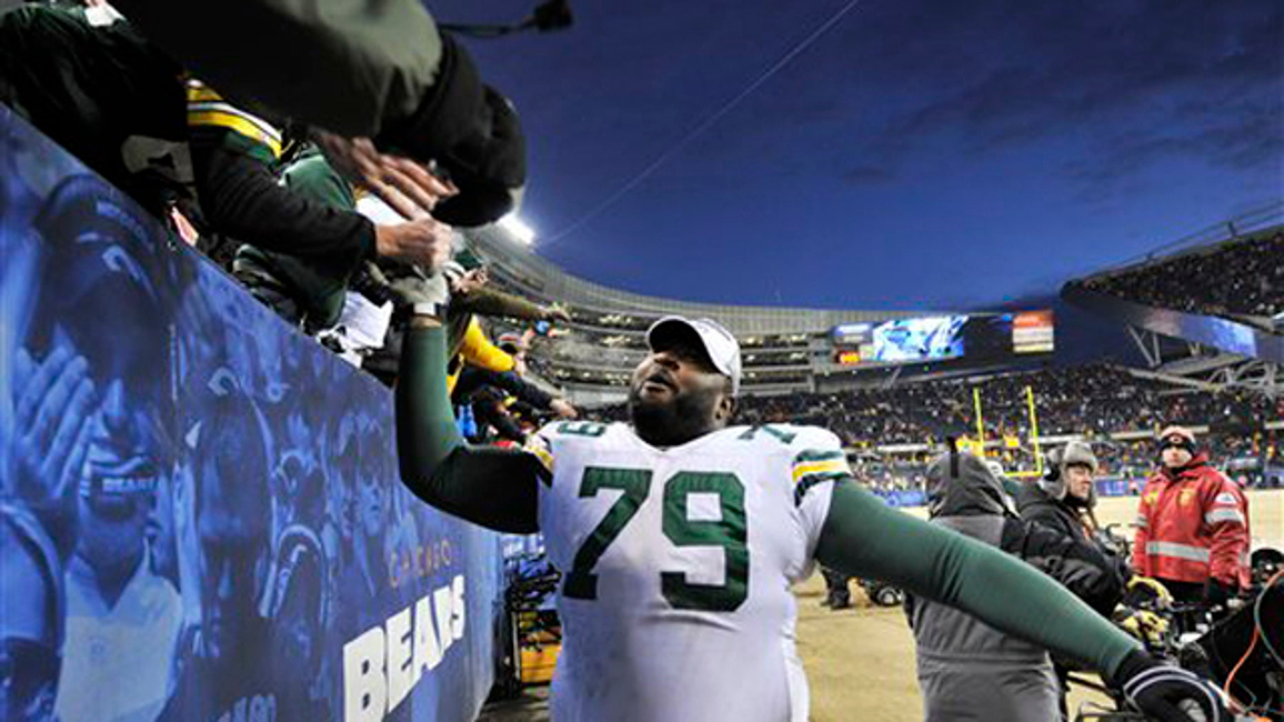 Jan. 23, 2011: Green Bay Packers defensive tackle Ryan Pickett celebrates with fans after the Packers' 21-14 win over the Chicago Bears in the NFC Championship NFL football game in Chicago.
