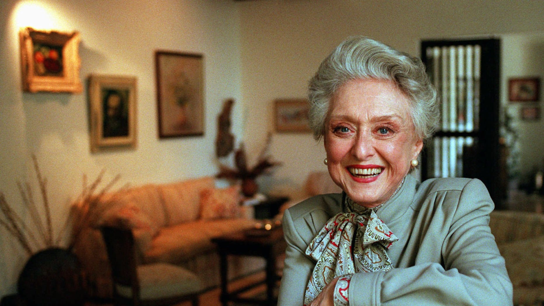 In this March 12, 1997, file photo, actress Celeste Holm poses at a friends' home in Santa Monica, Calif.
