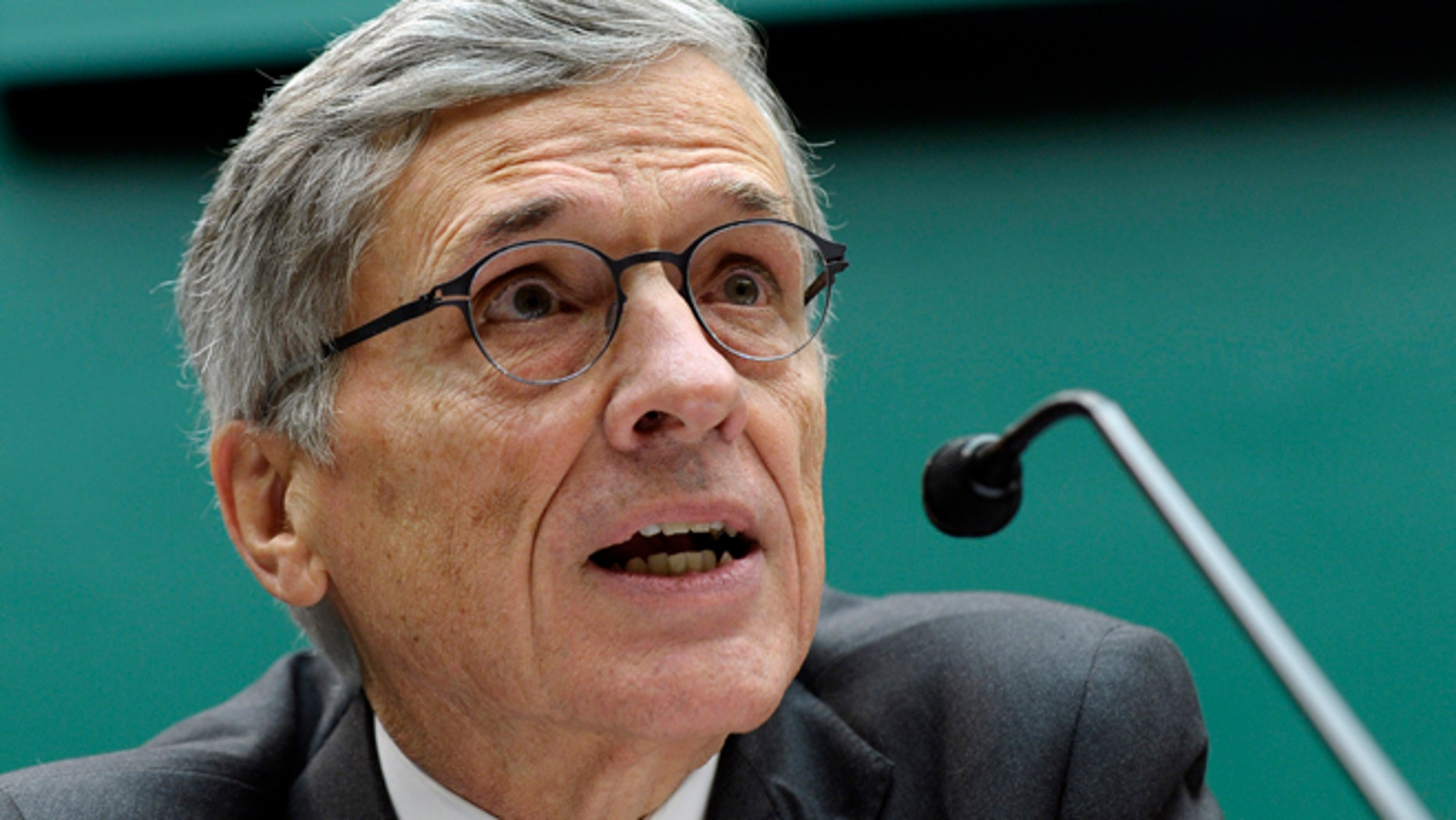 Dec.12, 2013: Federal Communications Commission (FCC) Chairman Tom Wheeler testifies on Capitol Hill in Washington.