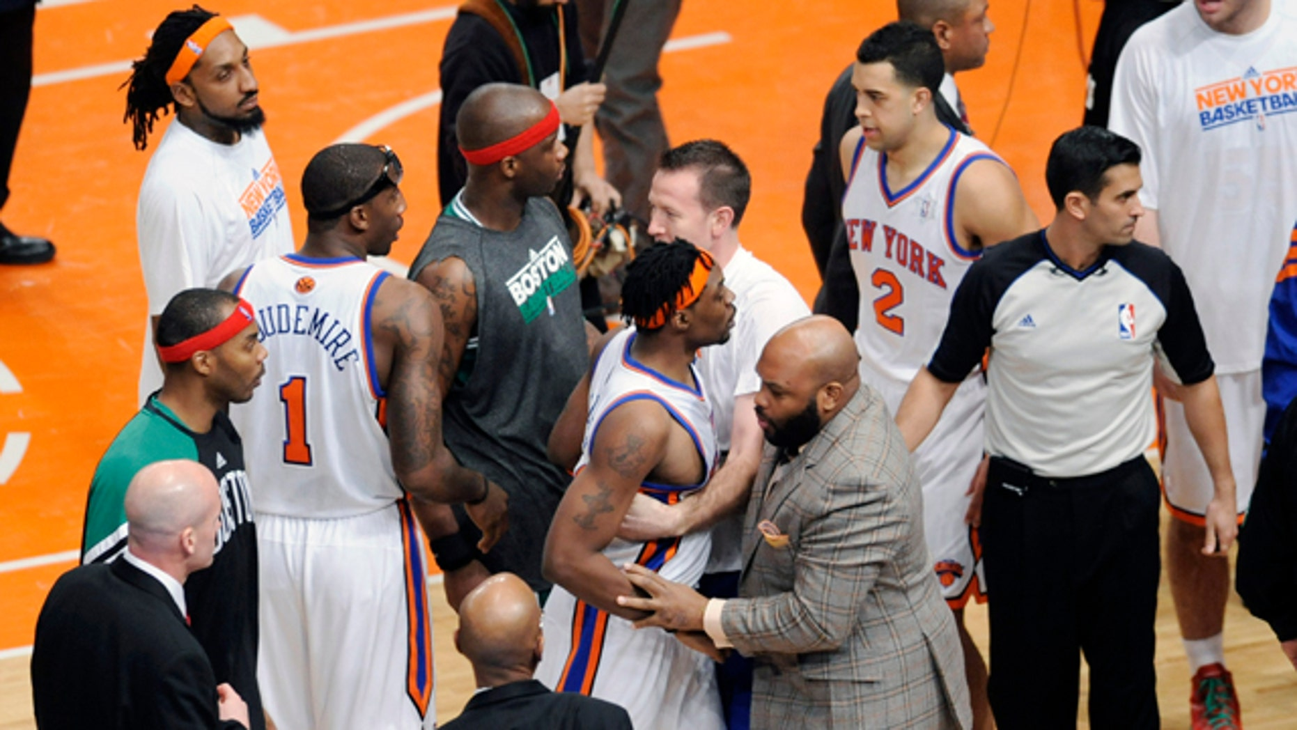Dec. 25, 2011: New York Knicks' Bill Walker is restrained at the end of the NBA basketball game against the Boston Celtics at Madison Square Garden in New York.