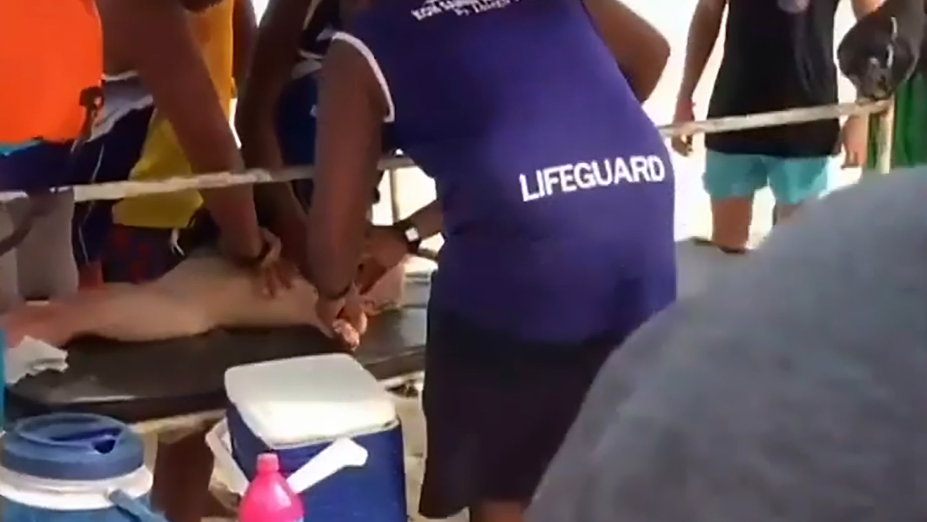 Pic shows: boy being attended by paramedics;