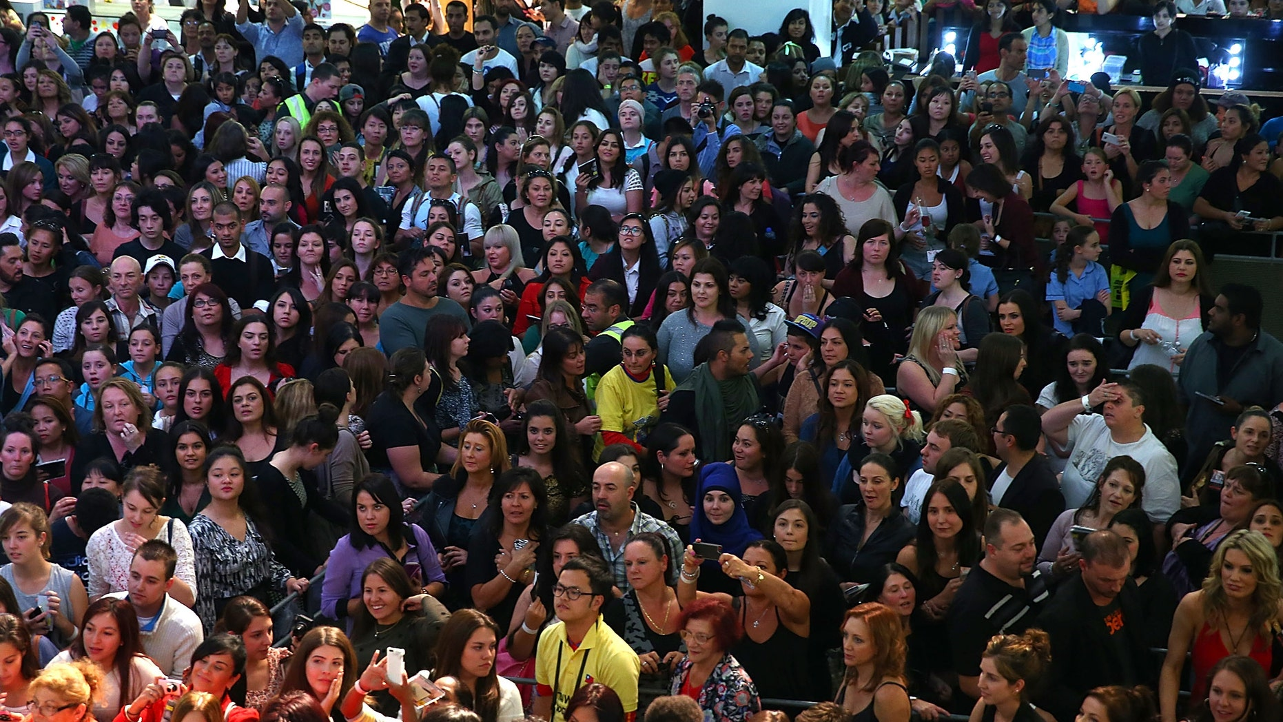 SYDNEY, AUSTRALIA - MAY 09:  Crowds cheer as they wait for an autograph signing with Ricky Martin during a promotion for his Greatest hits release at Westfield Paramatta on May 9, 2013 in Sydney, Australia.  (Photo by Marianna Massey/Getty Images)