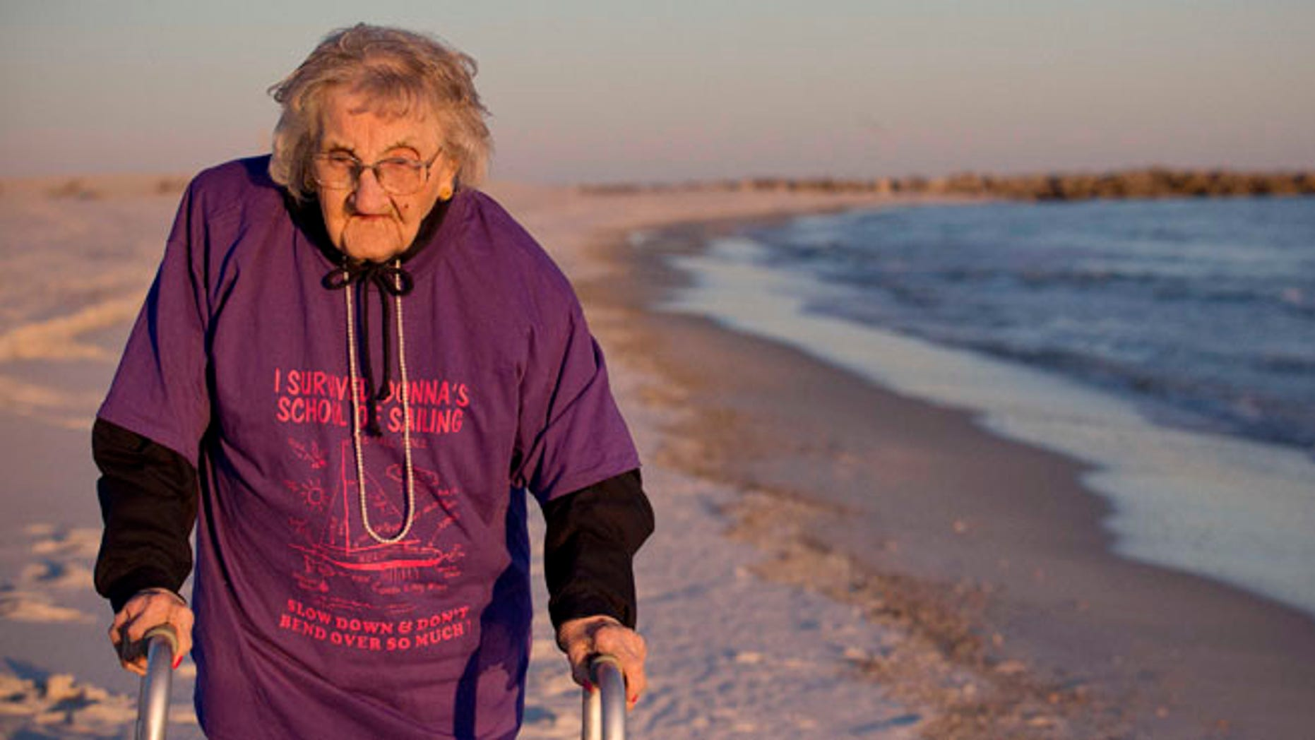 Nov. 19, 2014: Ruby Holt, a 100-year-old Tennessee native, walks on the beach for the first time in her life in Orange Beach, Ala. (AP)