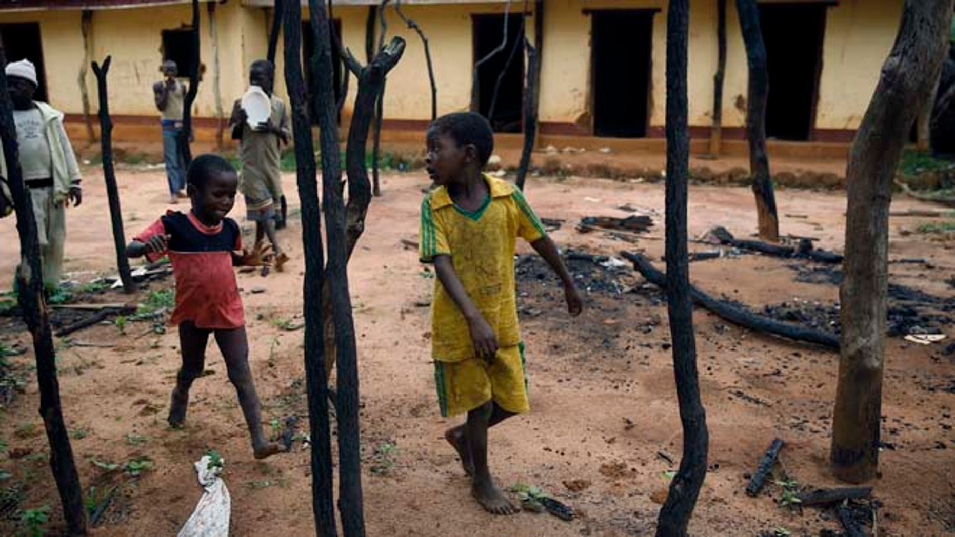 In this April 15 2014 picture, children walk through the burned  Muslim district in the Western Central African town of Guen, Central African Republic. (AP)