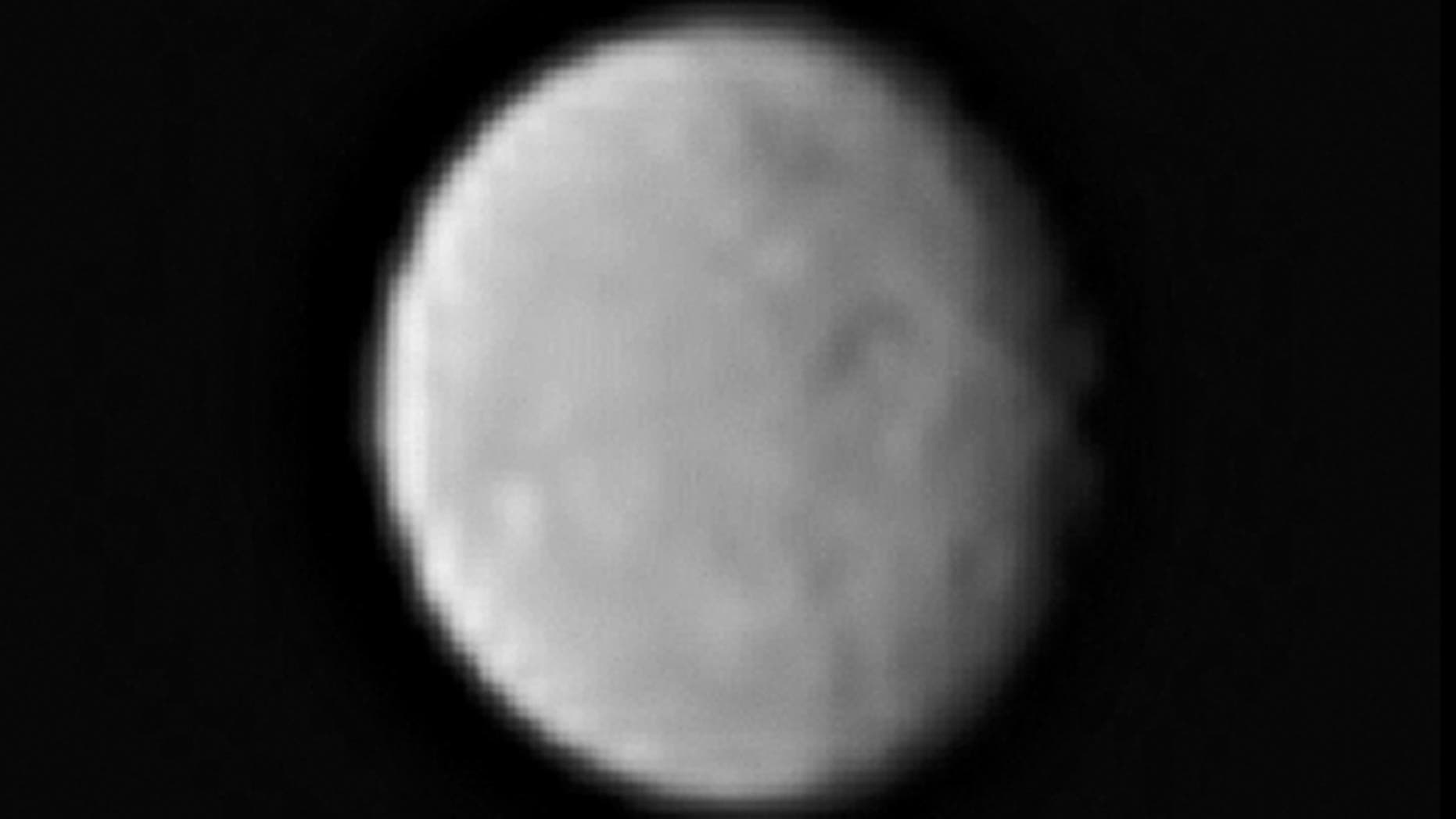 This processed image, taken Jan. 13, 2015, shows the dwarf planet Ceres as seen from the Dawn spacecraft. The image hints at craters on the surface of Ceres. Dawn's framing camera took this image at 238,000 miles from Ceres.