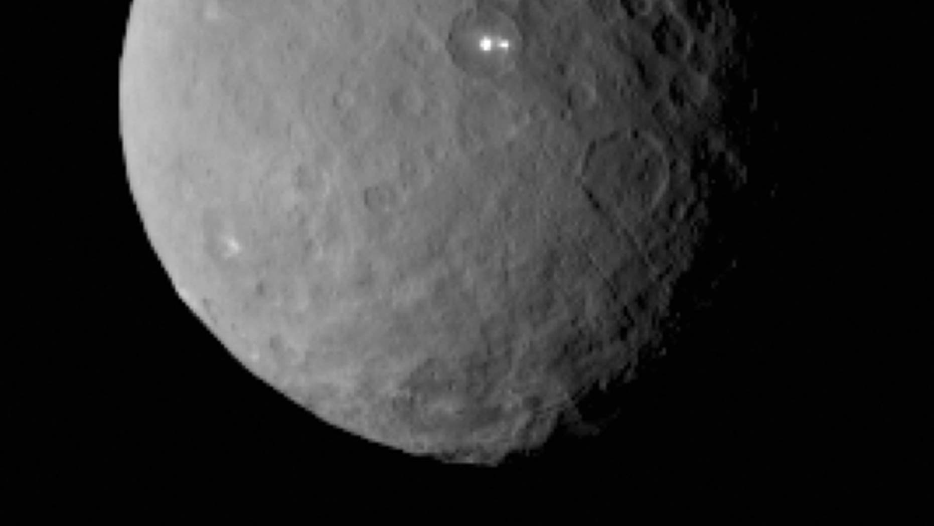 The brightest spot on Ceres possesses a dimmer companion, which apparently lies in the same basin.